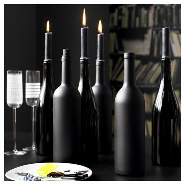 You can also spray paint your wine bottles a black matte and black gloss finish. Use your old wine bottles as candle holders with black candlesticks.