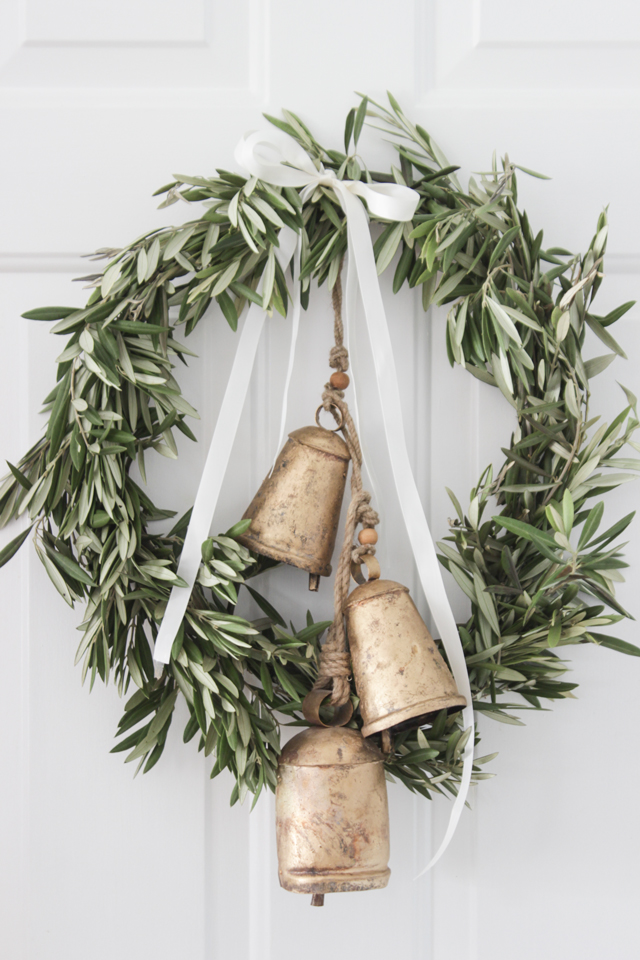 Love this wreath.  The vintage bells puts a nice touch to the front door.