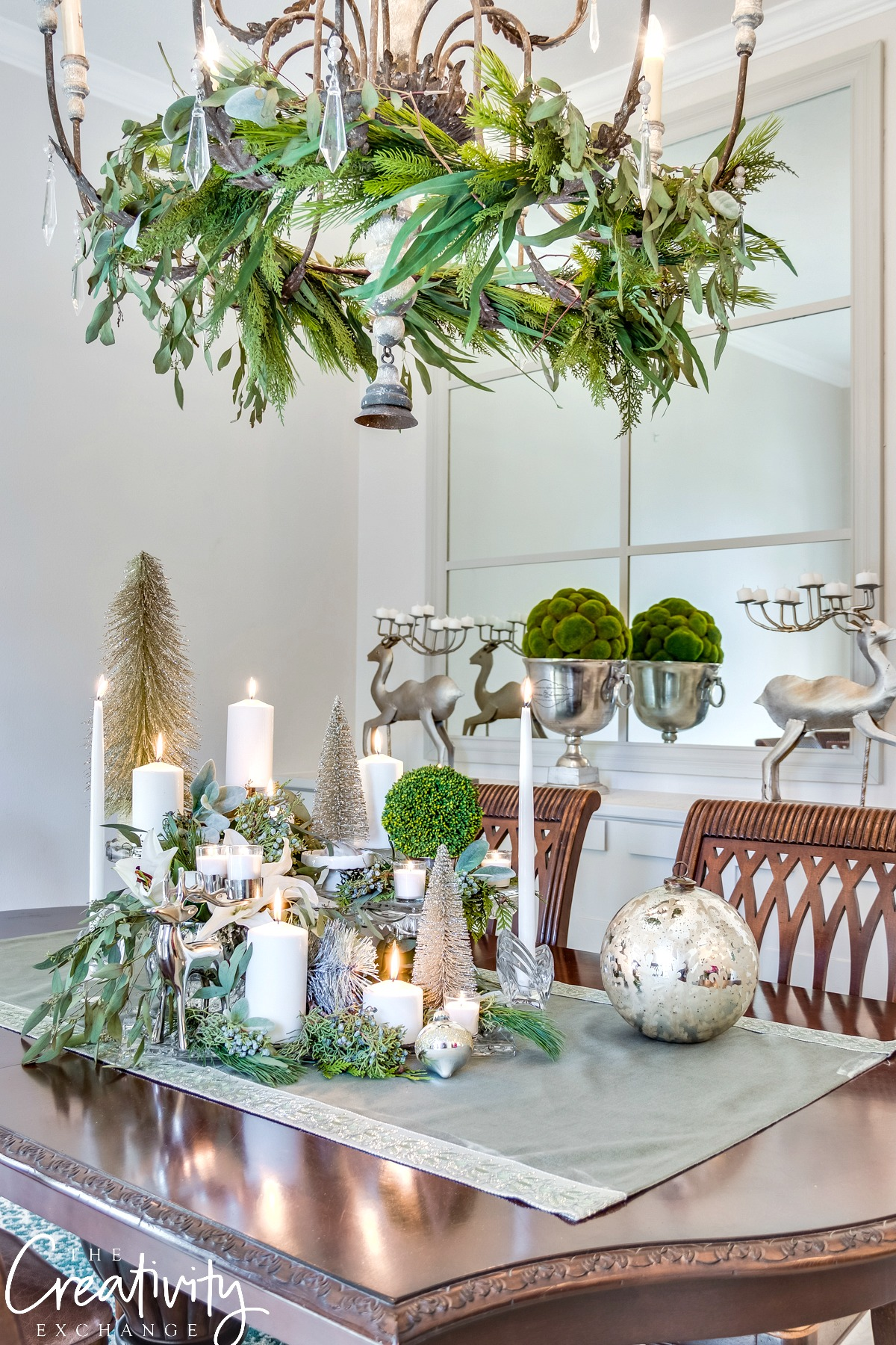 Love the different trinkets mixed with candles and greenery.