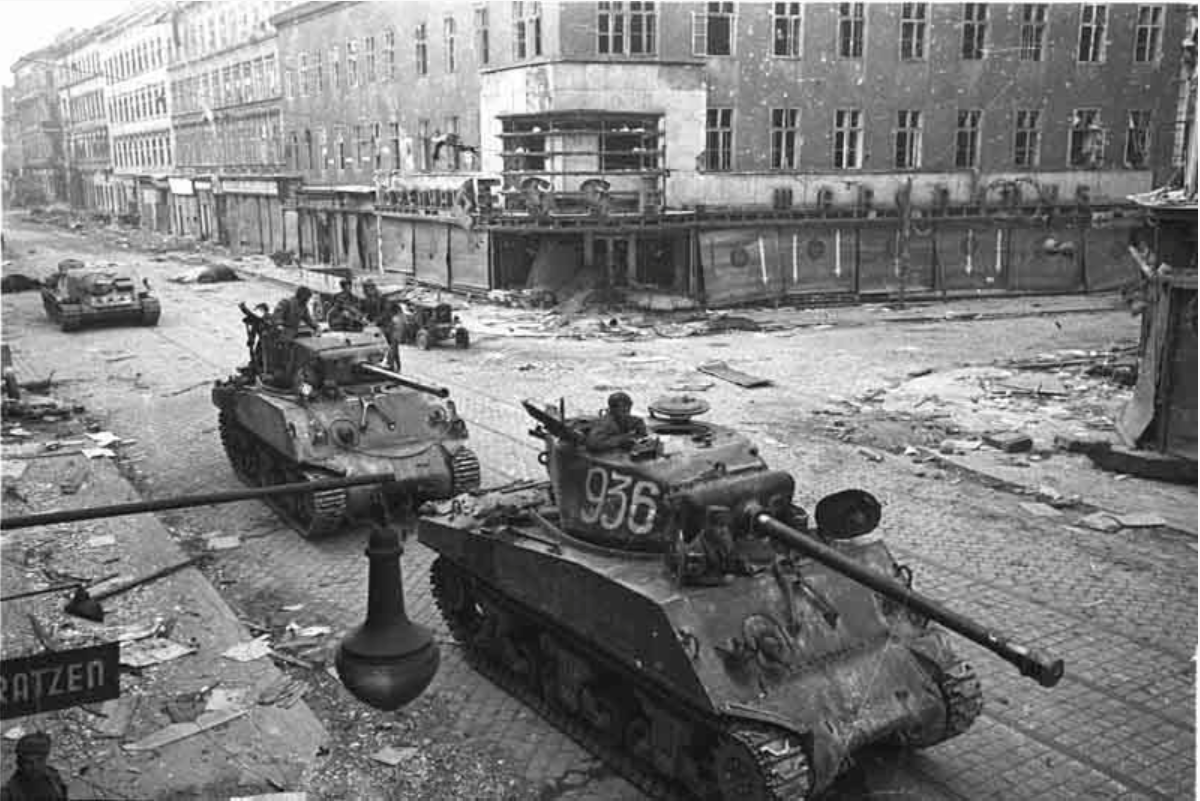 Two Shermans and SU-85 of 9th Guards Mech Corps in Vienna 1945