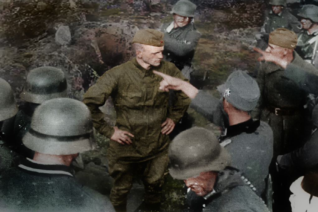 This picture taken on June 30, 1941 shows German Jagers from 136th Tyrol Mountain Regiment of the 2nd Mountain Division of the Mountain Corps Norway extrajudicially killing Soviet POWs. Barely a week into the war, Soviet POWs, who bear their heads high and facing death, are executed on sight.