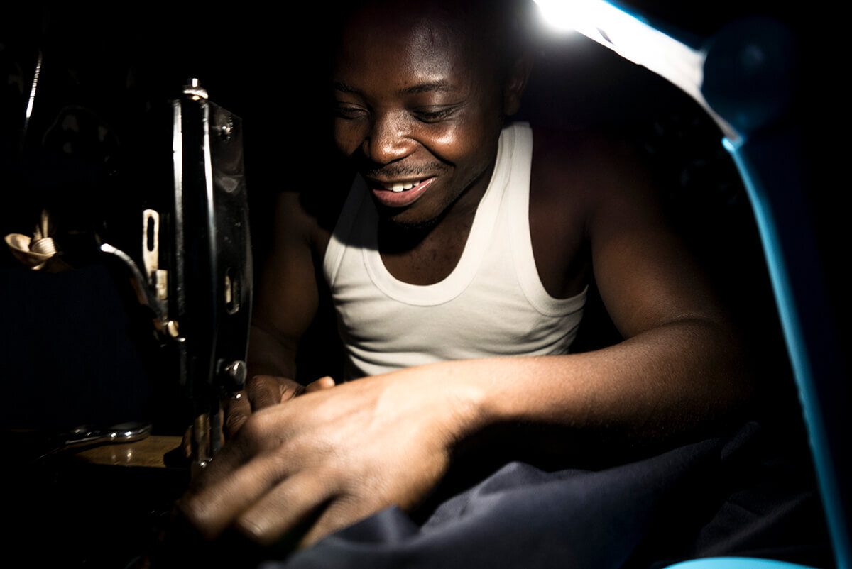 An Altech customer uses a solar lamp to light his work.