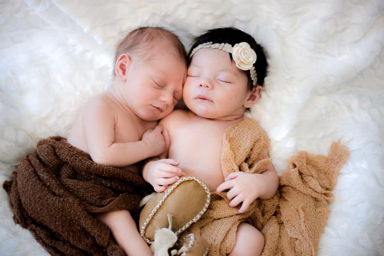 newborn cousins snuggle during in home newborn session