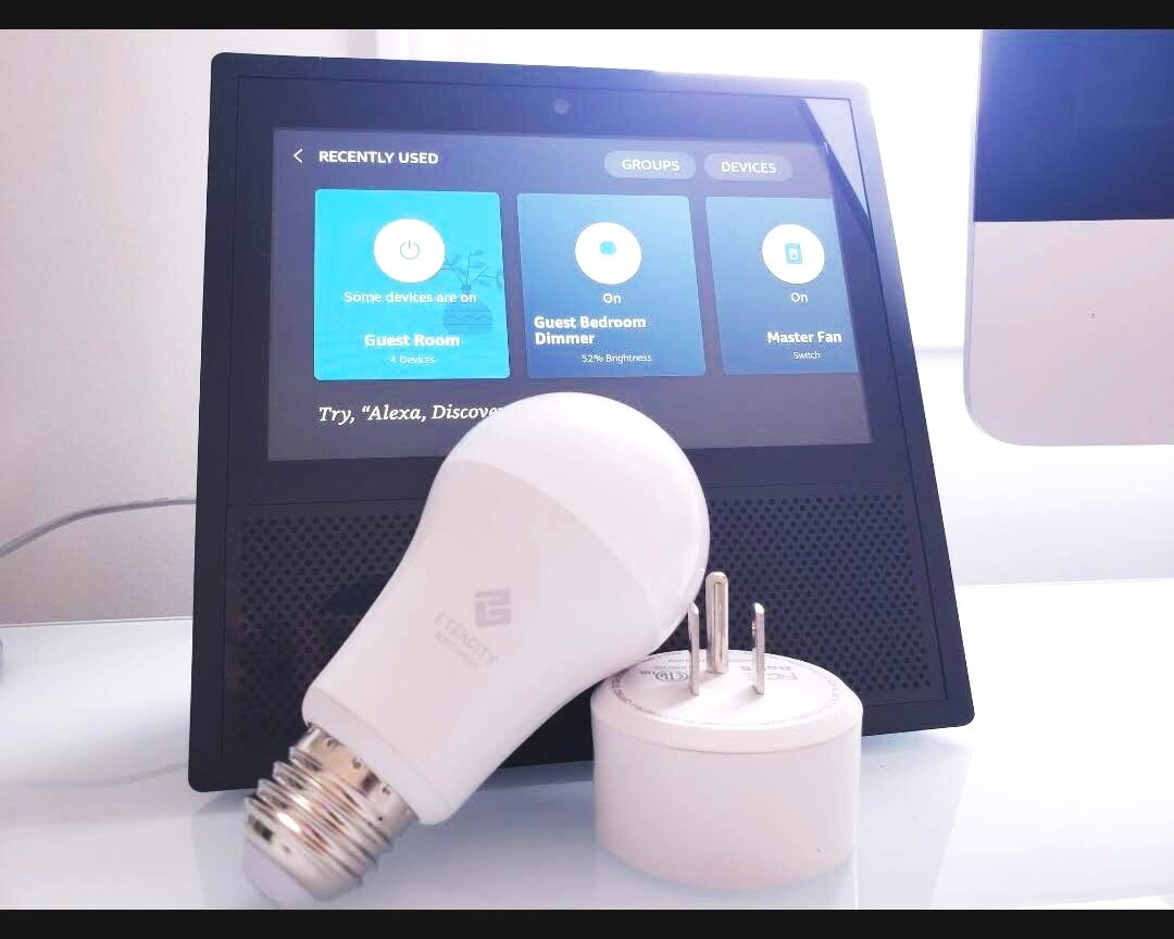 The  Etekcity smart white light bulb  shown works with Alexa lighting control.  Echo Show  with lighting control touch screen.