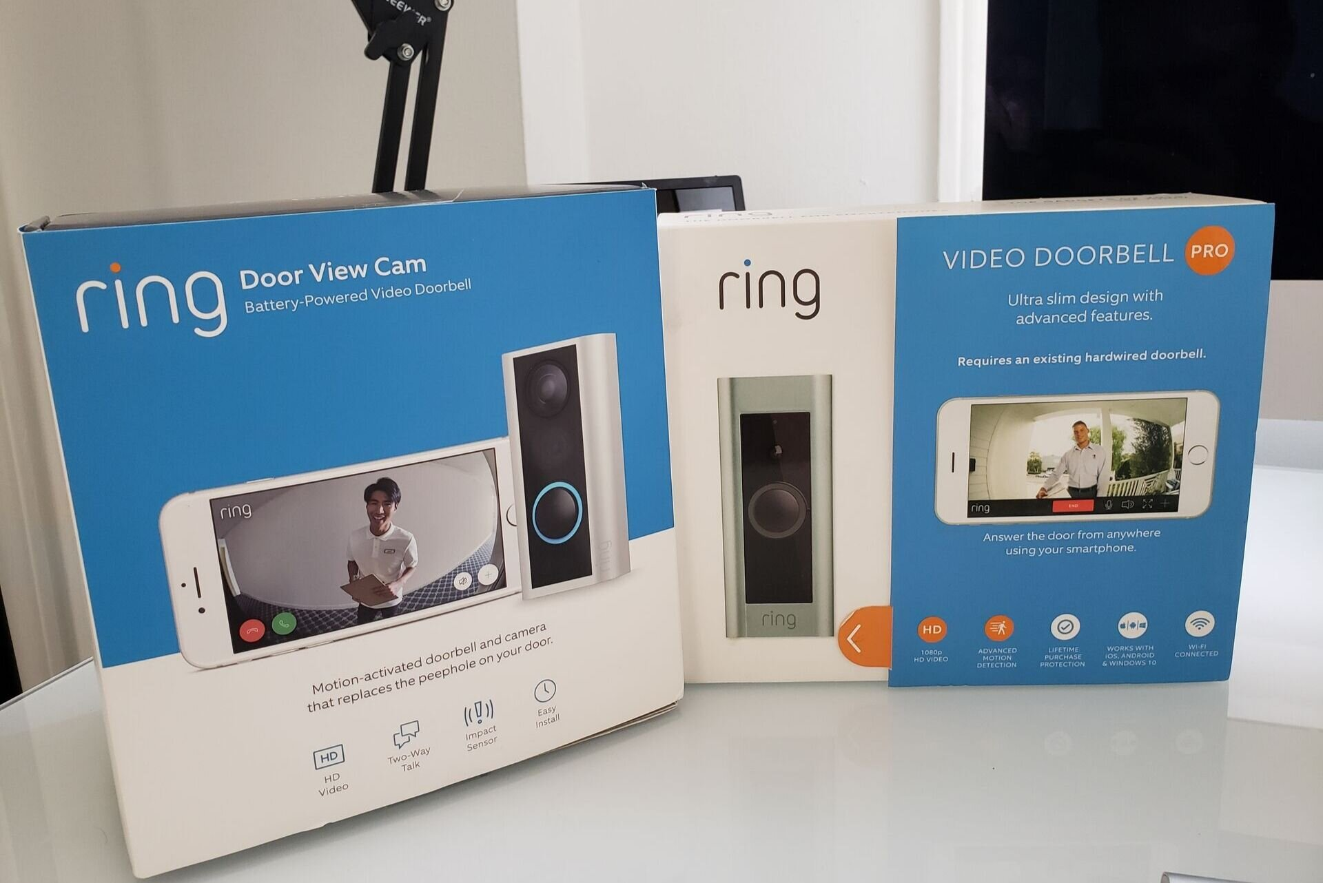 Ring Pro Doorbell  & Ring Door View Cam Shown. The Ring Door View cam is designed for use in doors with peepholes and can be installed in the existing peep hole. The Door View Cam is battery powered and wireless.