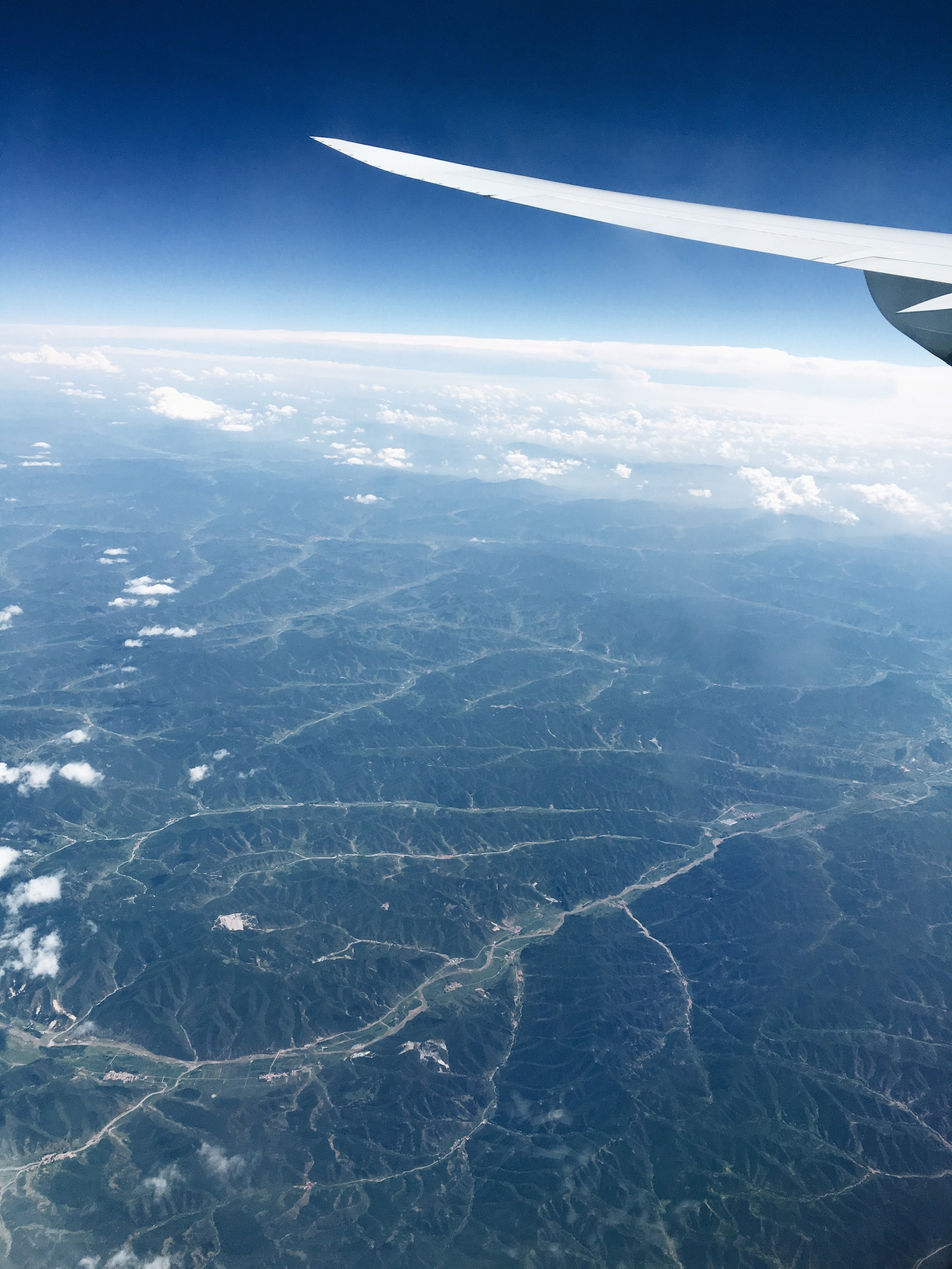 Some views are just worth the plane ride... Somewhere over China!