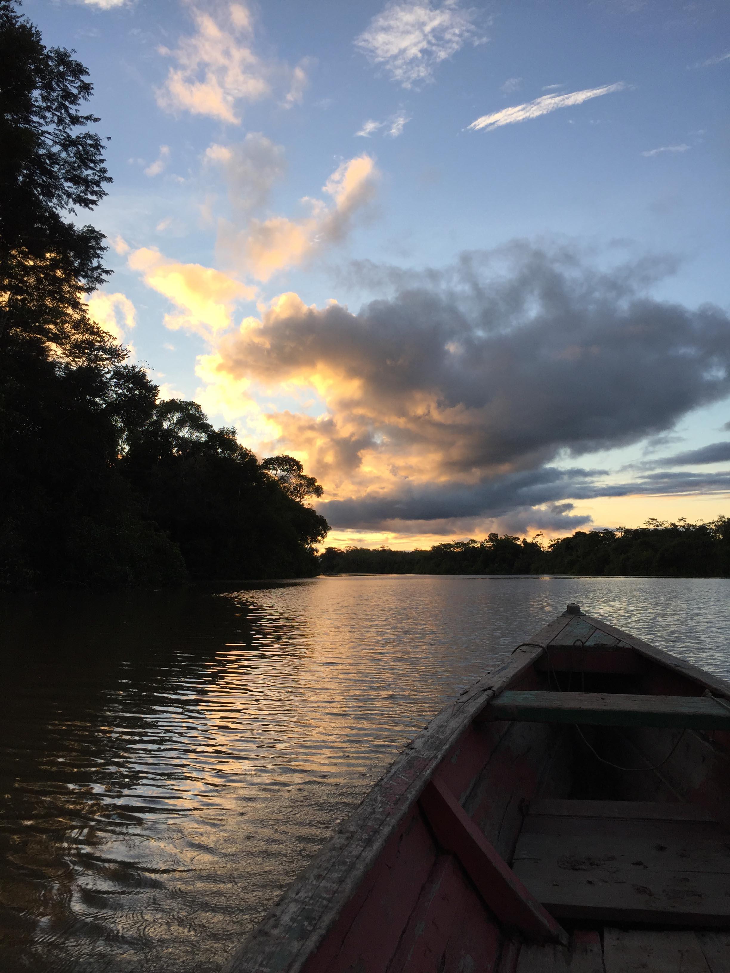 Sunset on the canoe in the Amazon Rainforest.