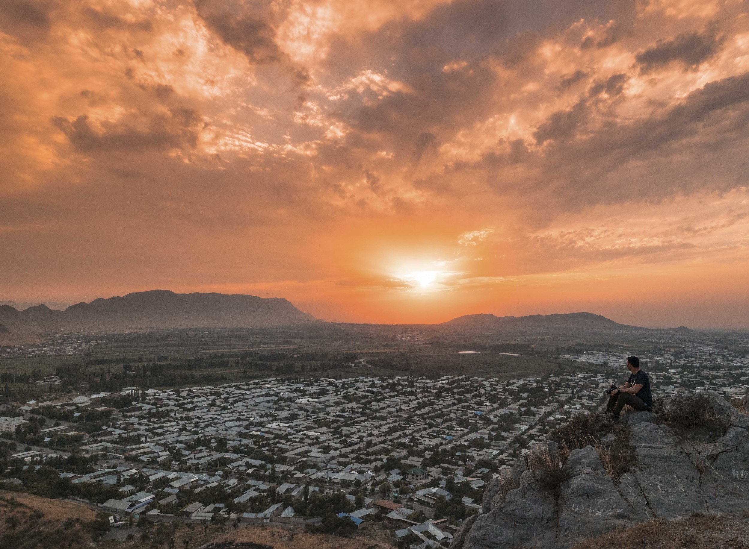 Watching the sunset in Sulaiman Too in Osh Kyrgyzstan. Photo: Kel Morales.