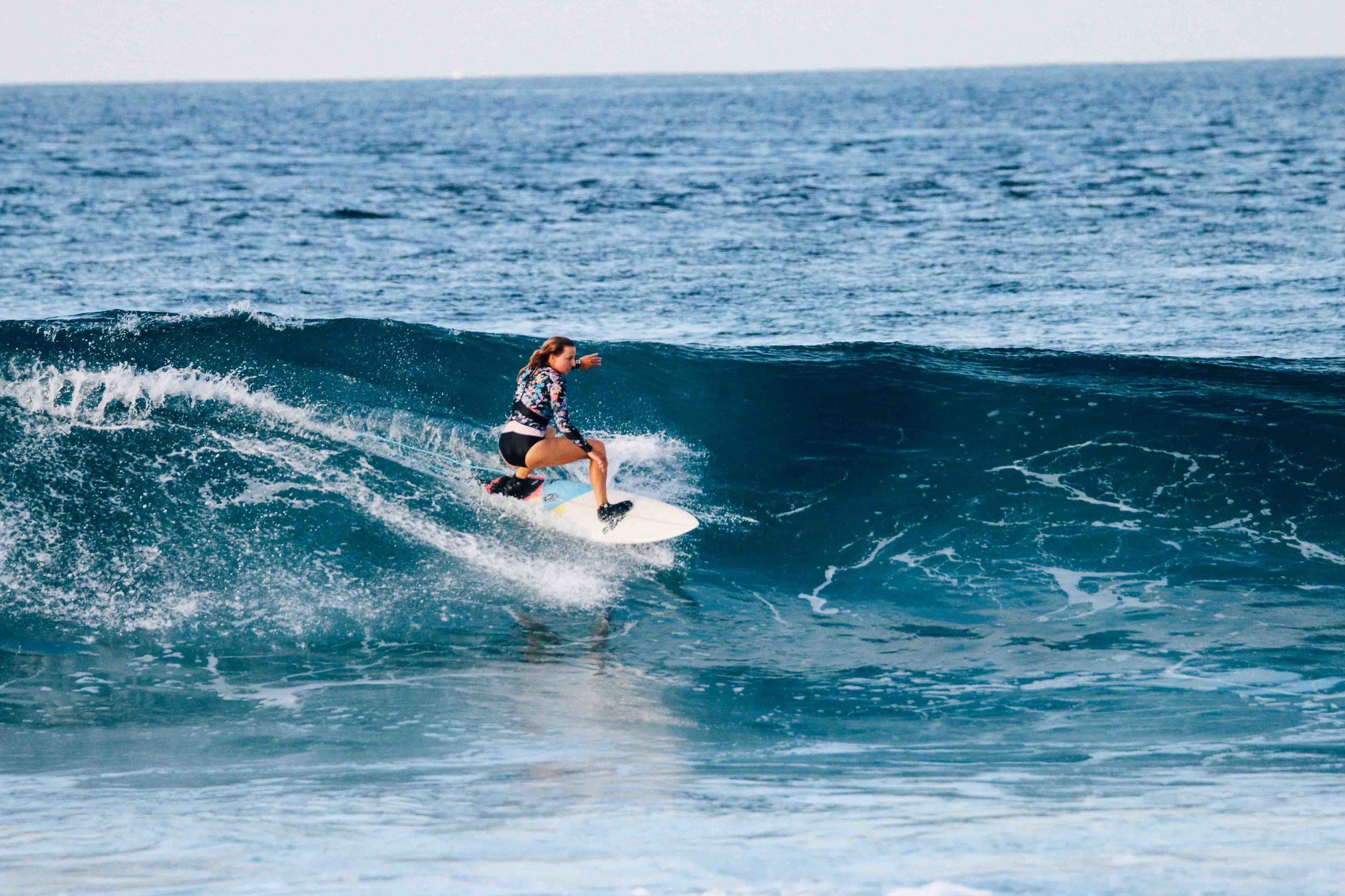 Zoe on a wave in the Maldives.