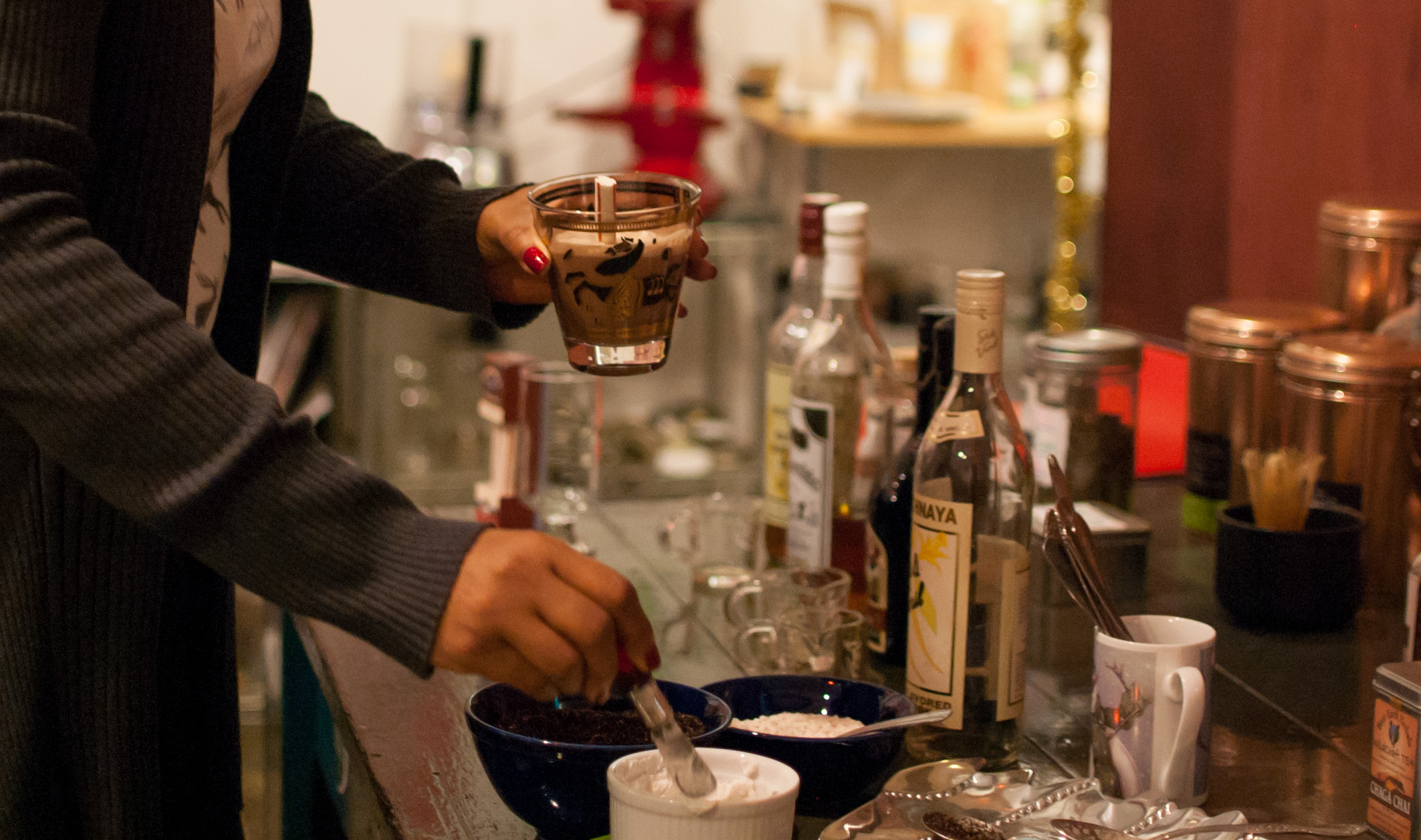 a hot cocoa bar equipped with peppermint stir sticks, crushed candy canes, cookies, coconut cream, and...booze!