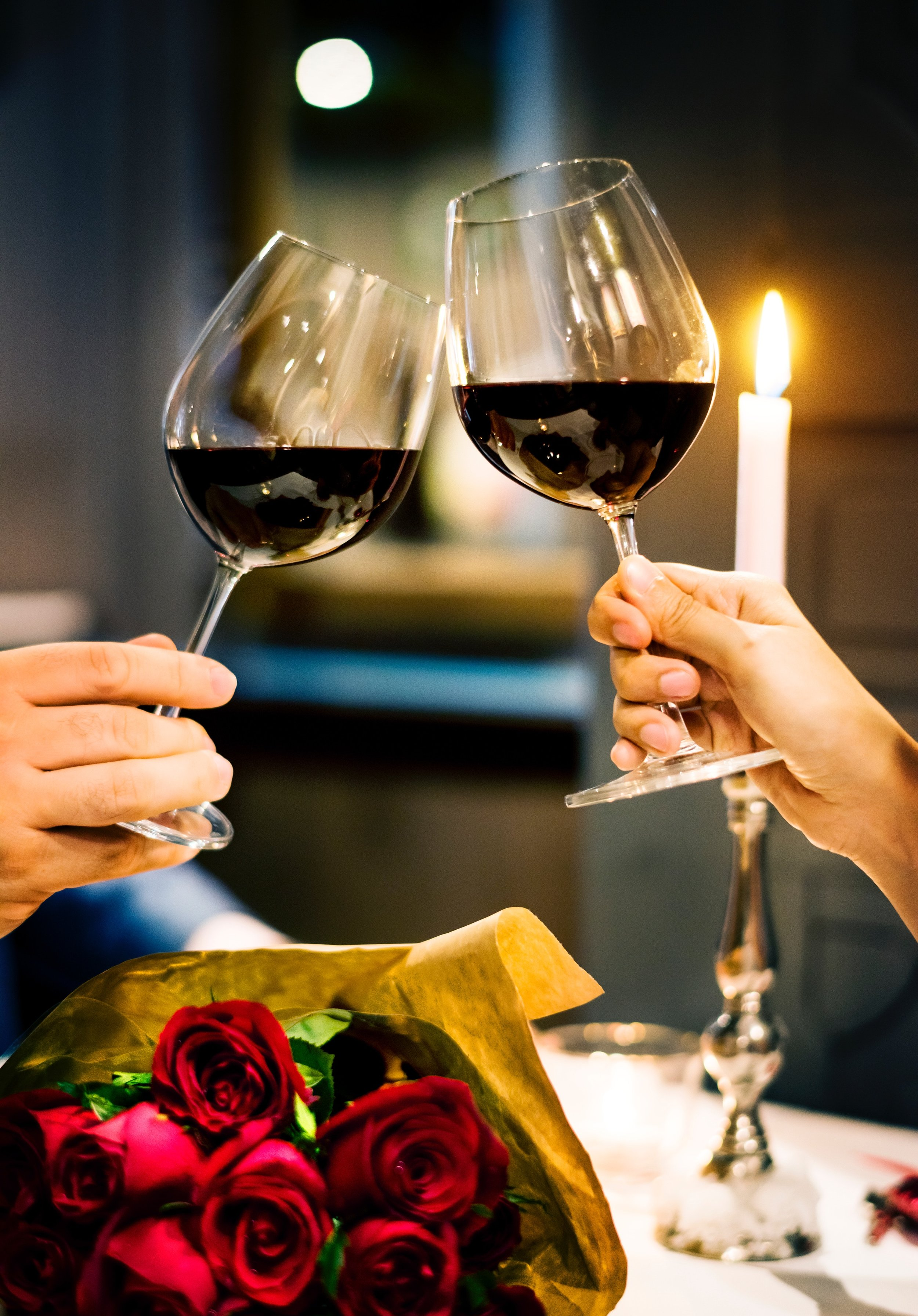 Wine glasses and bouquet of roses by rawpixel