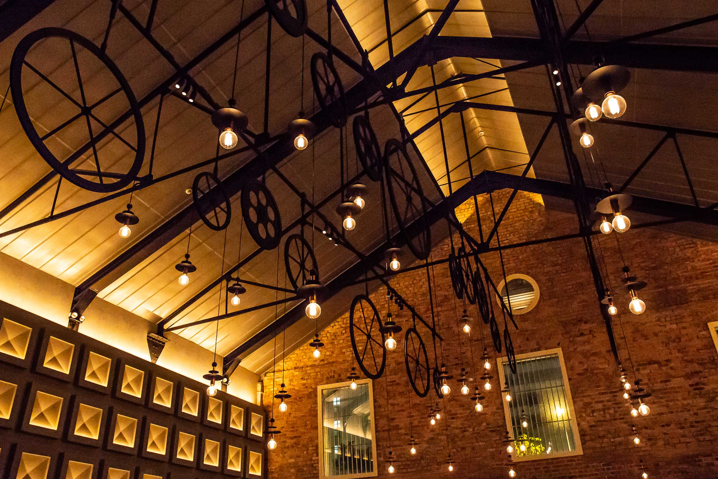 Industrial Inspired Lighting Hangs from the Vaulted Ceiling, The Warehouse Hotel, Singapore