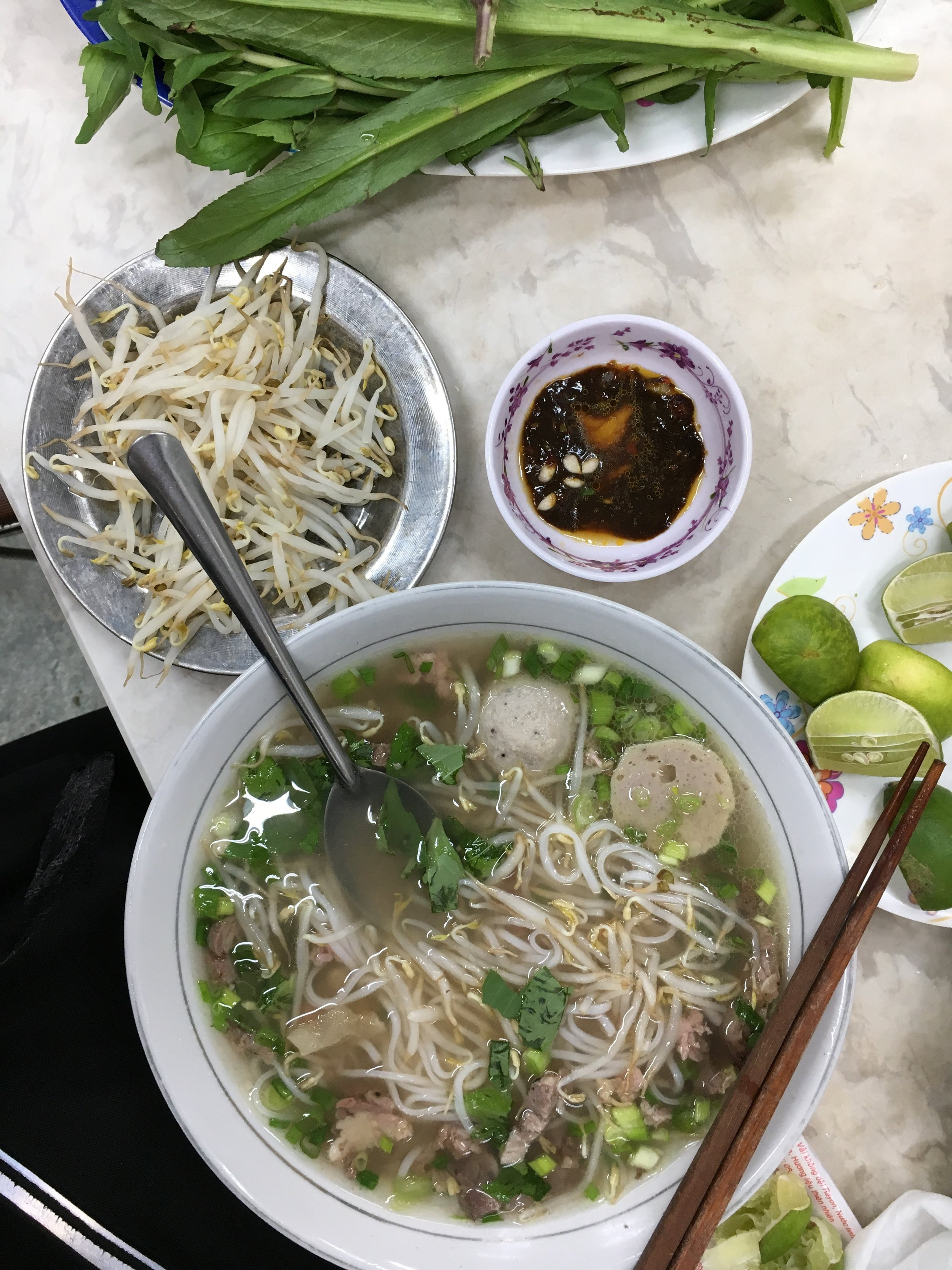 It comes with herbs - basil, coriander, and mint, and comes with beansprouts and sauces to add. This is after mixing a few of the ingredients together. Just a little bit of something can change the atmosphere of the entire bowl. You've got to find what's right for your taste buds.