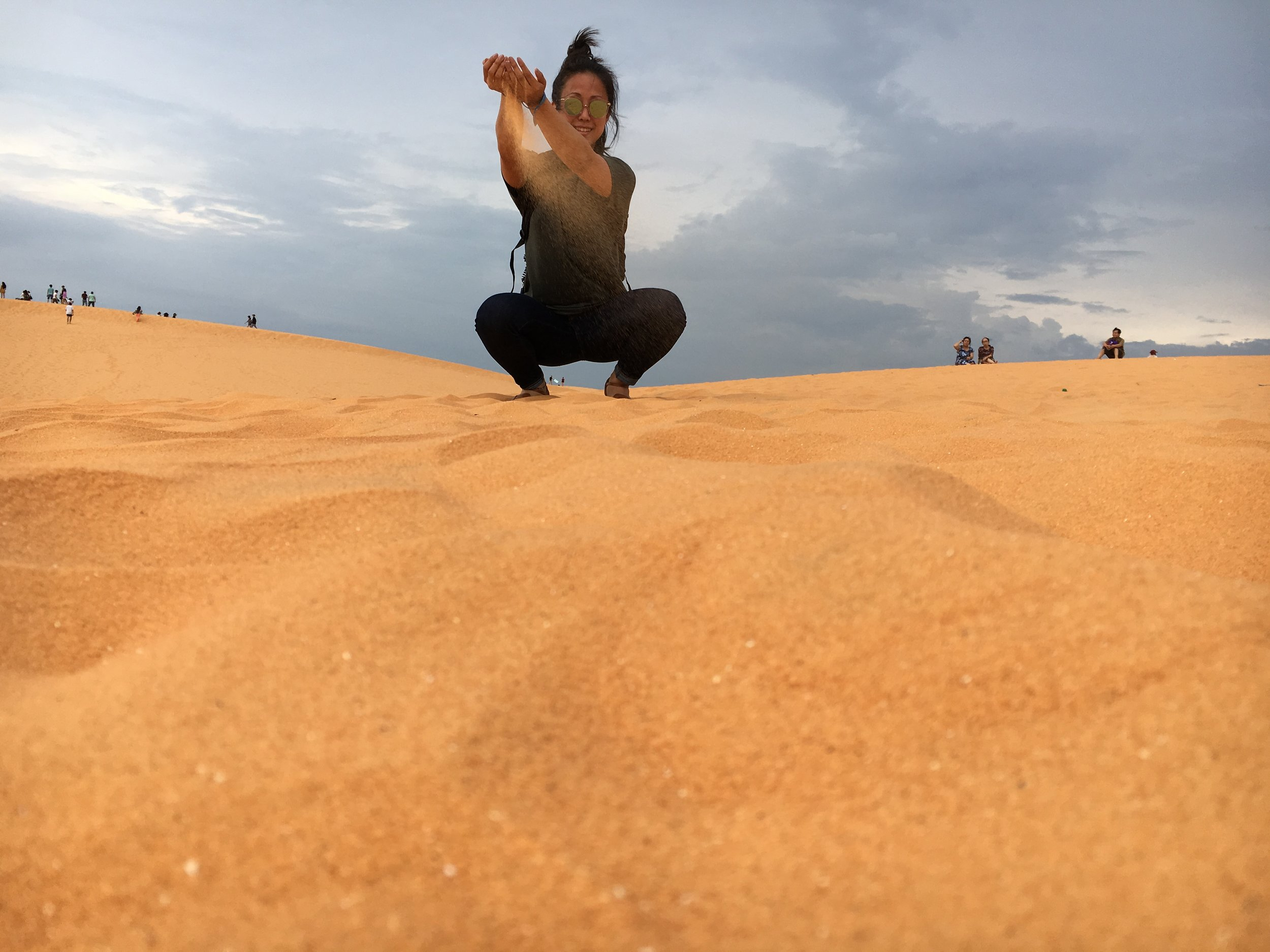 Playing with fairy dust at the Red Sand Dunes of Mũi Né.