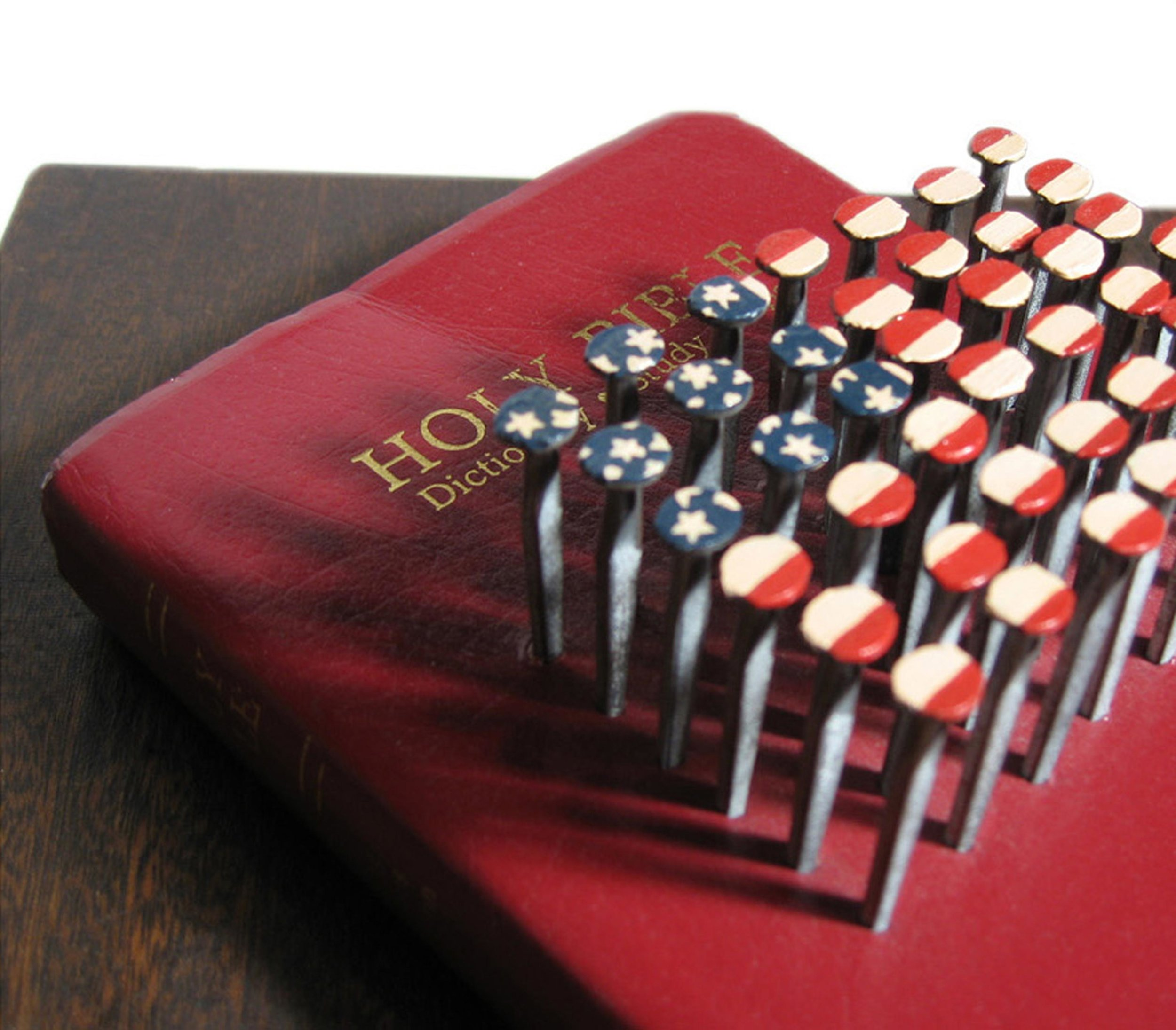 Nails and Bible  Detail of painted nails in bible