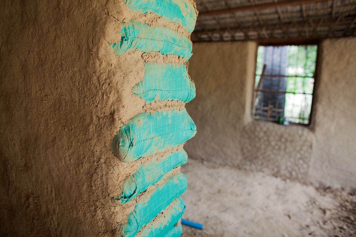 The incomplete mud-walls of the library hut.