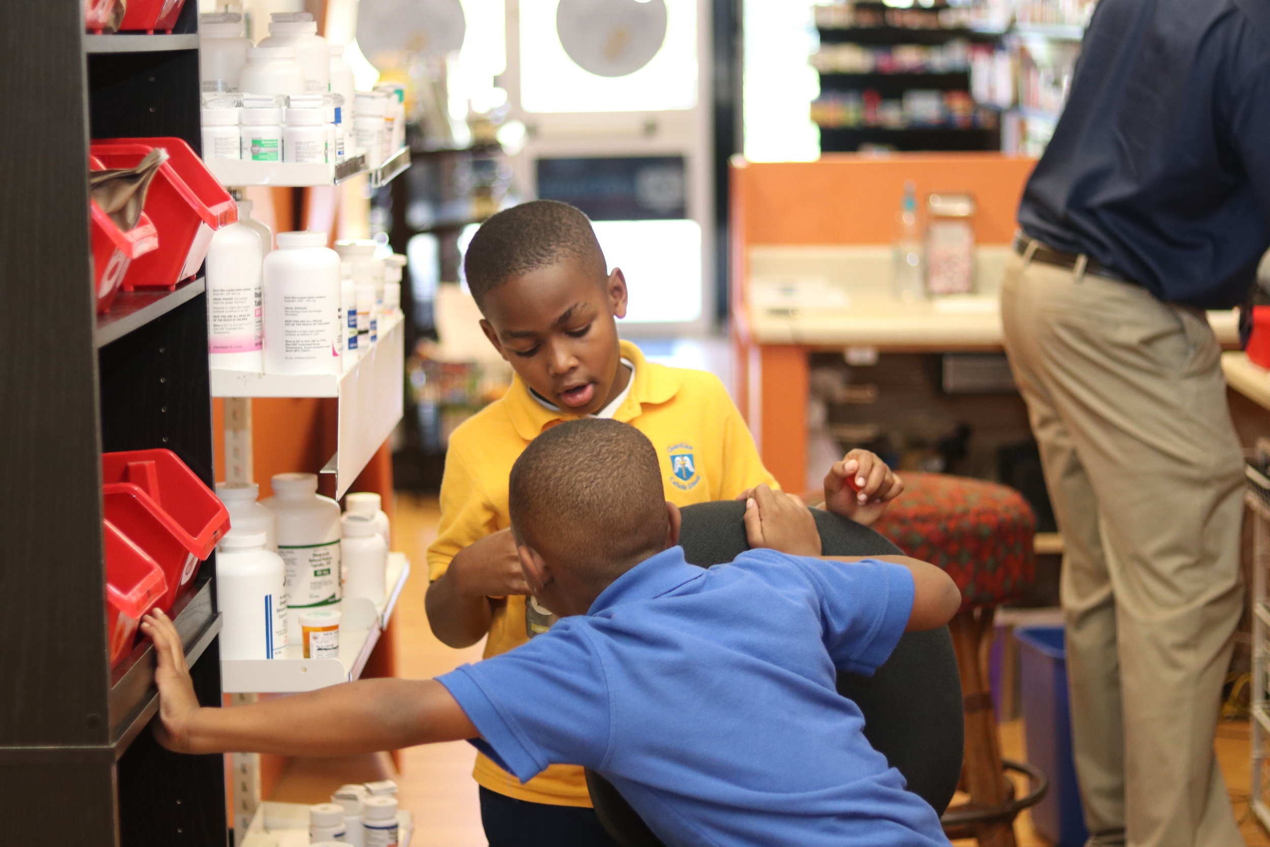 Albert's sons love to stop in for a quick hello whenever they can after school to visit their father in his place of business. Aiden loves to tell people that he's a pharmacist just like his dad.  Photo by The Talented Tenth