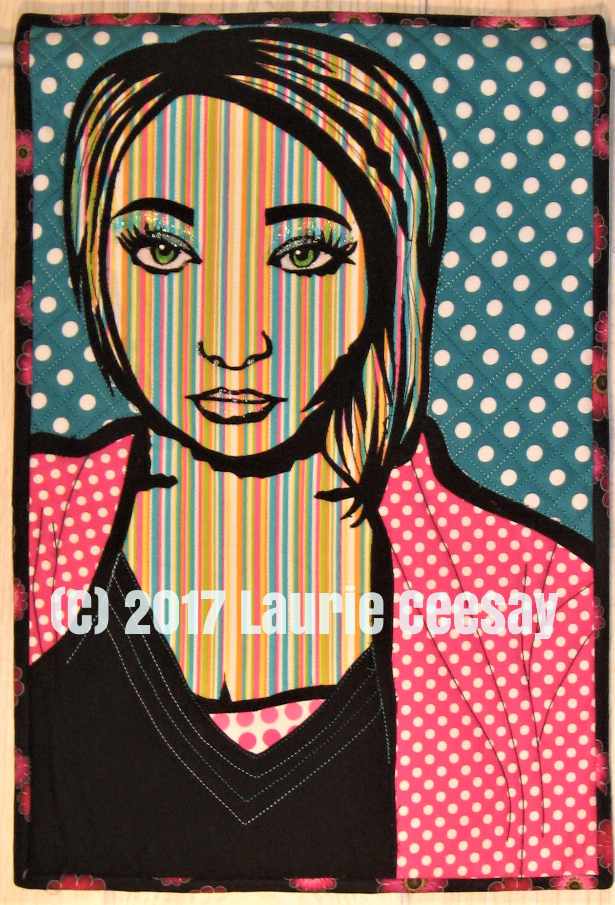 "Today is reveal day for my Facebook art quilt group Art Quilts Around The World. I got to select the theme this time and I chose Pop Art. I love Pop Art and have made a few quilted wall hangings, including my first art quilt, that had this theme. I love Andy Warhol and Roy Lichtenstein. I love the manipulation of photos to get this look, I love words on quilts similar to comic strips, I love polka dots and stripes and I love bright colors!  I had the honor to again teach my portrait quilt ideas at the International Quilt Festival in Houston earlier this month. I taught a new class ""Line Drawing Portrait Drafting Class"" and wanted the students to have a few trial run sample portraits to play with to get the idea I was presenting. I have a co-worker Alexis at the hair salon who is photogenic and I got her permission to use her Facebook photo for the class.   After I returned home and was unpacking I discovered the drawing sample of Alexis could be adapted to my Pop Art Challenge. Below is the process."