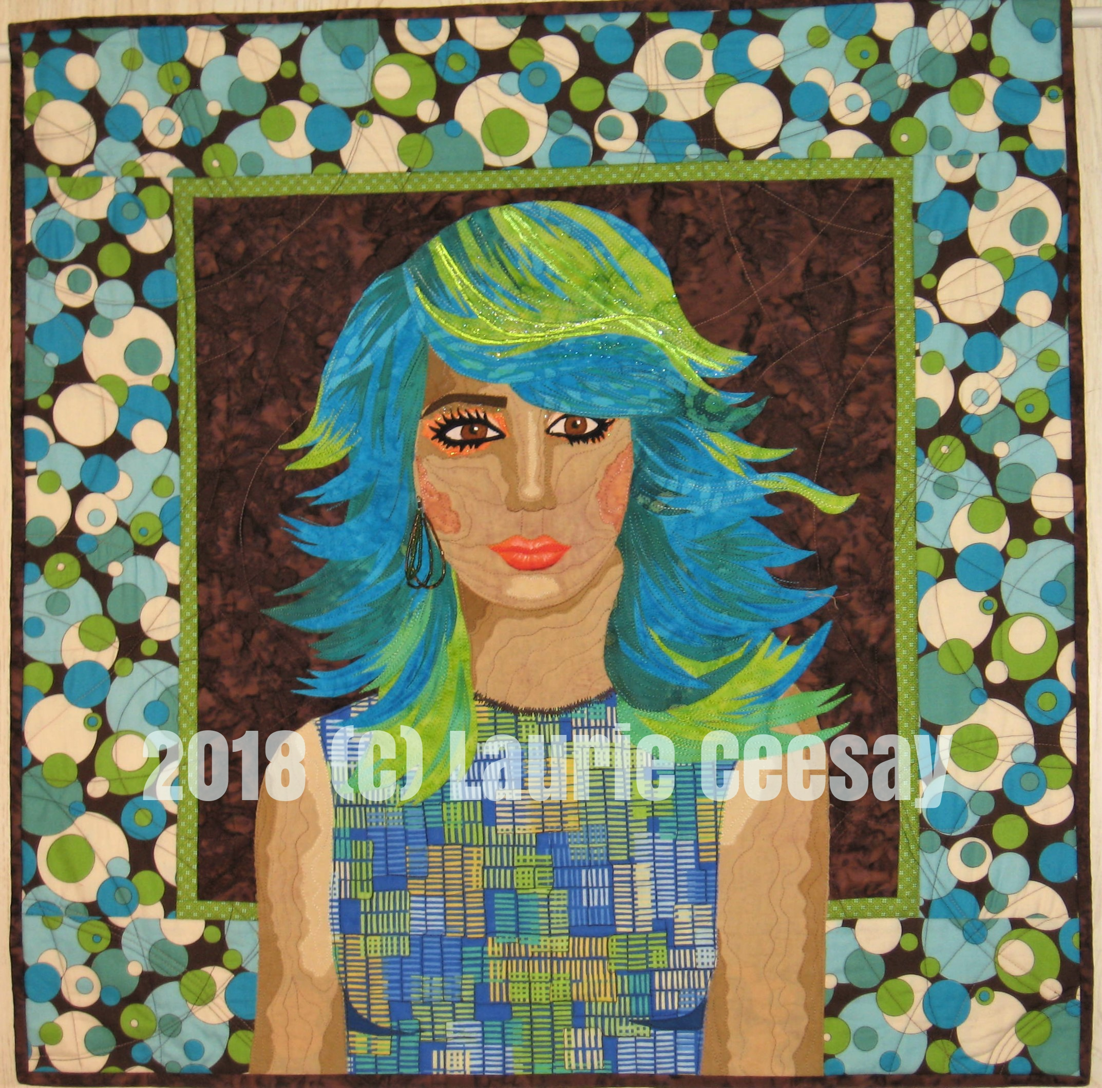 "In February I was invited by Susan Brubaker Knapp, the host of Quilting Arts TV on PBS, to participate as a guest artist. I taped 3 segments in April on Pop Art Portraits, Dollar Store Embellishments and Realistic Hair Techniques in Portrait Quilts. This quilt was made for the purpose of being a working sample for the Realistic Hair segment.   As a hairdresser I am exposed to a huge amount of hair color options and bright fake colors are popular. I had purchased the outside border fabric a while back and chose to use it in this quilt thus creating the analogous color scheme. Mermaid hair color (kelly green, lime green, turquoise and possibly blue) was my inspiration and then featuring the 1970s Farrah Faucett style haircut with the strong full side swept bangs and side layers. I am not a huge fan of brown in my work but it seemed to fit as the background.  I made the majority of the quilt in March then sewing on the TV show's sewing machine sponsor's machine, a fancy Bernina, right out of the box to do the demo. The sewing machine rep, Jeanne Delpit from FL, sets up the machine with the selected thread, foot and stitch length. She physically moves it onto the set. My taping segment was for 8 min. so the actual sewing time on camera is minimal for all the prepping done!   I returned home and put the quilt on hold until I completed other deadline projects. I finished it this week! It is titled ""Farrah Wings!"" which is a hairdresser jokey name!"