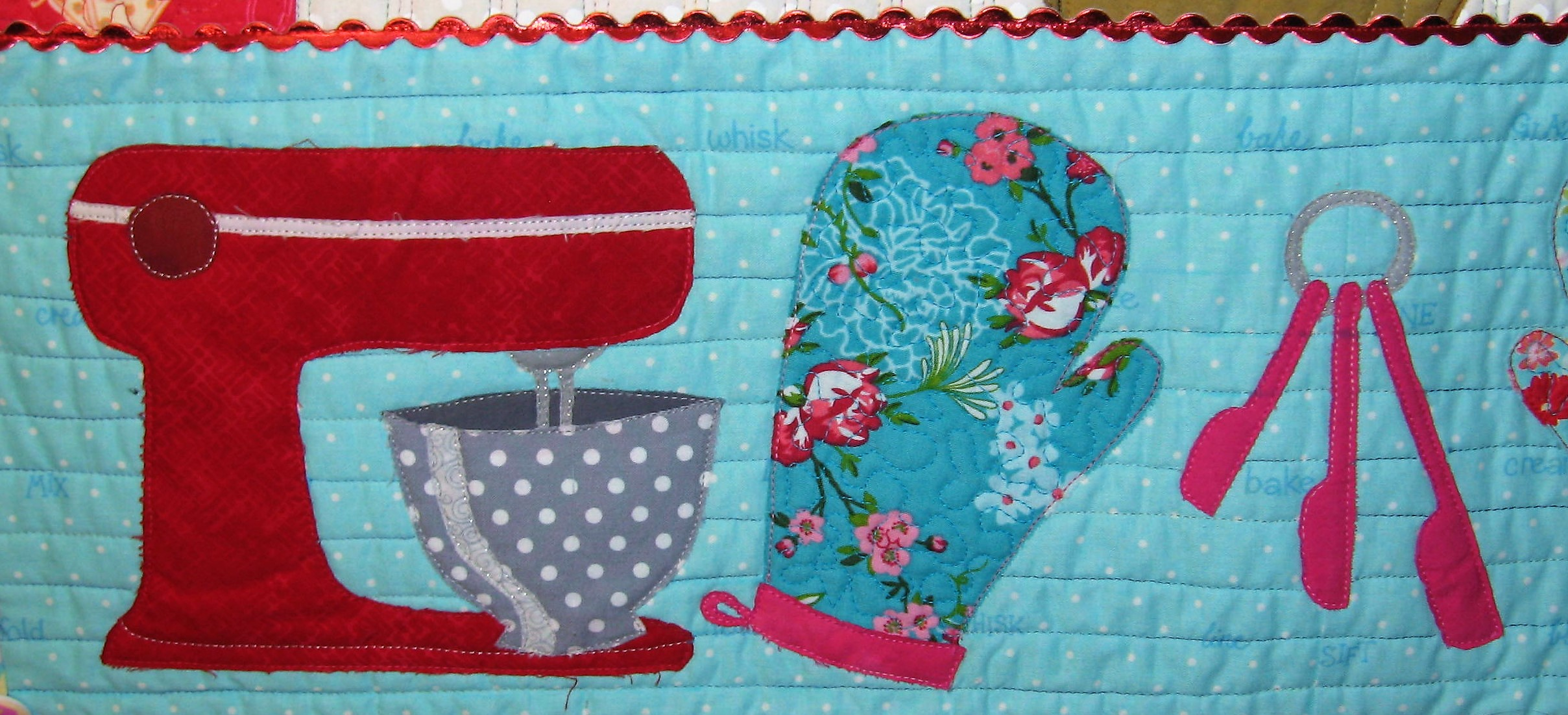 The bottom portion of the quilt has two red Mix Masters with polka dots bowls, two oven mitts and measuring spoons. I added the metallic red rick rack because I thought it needed something and rick rack has a retro vibe often used as trim on old aprons.  June 30, 2018 is the deadline for the contest and I have had this quilt finished for a month waiting for the deadline so I could share it. I believe I need to wait a few weeks to find out if Cupcake Betty is included in the challenge. All accepted quilts will travel for 2 years to various quilt venue across the United States.
