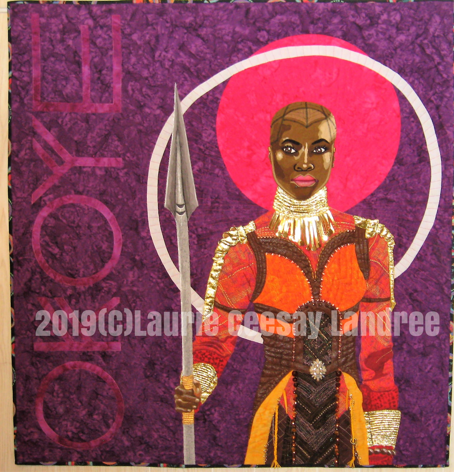 This quilt is called Okoye: Wakanda Warrior and I made it for the2019  International Quilt Festival's quilt contest called Quilted Comics & Sci Fi. Comic books, Comic Con, Star Wars, Star Trek and Games of Thrones are many of the possible options. When I watched the 2018 movie Black Panther I was in love with the female actresses and the powerful roles they played, their fantastic costumes and that bald head and beautiful face of Okoye the General of the Dora Milaje who project the Black Panther. I loved how women ran the military army and could still be beautiful! I also loved that Okoye carried a spear! When I learned of this quilt contest I knew this was the subject matter.   Black Panther began as a comic book so I felt I was safe choosing her.   I researched images from Pinterest and found an image I liked. I did not cheat and print the design from the internet. I drew the design  beginning on Sunday January 27, 2019 at a quilt retreat and realized the costume was very complicated. It was difficult to draw but it was so awesome I needed to continue and not wimp out on the detail.