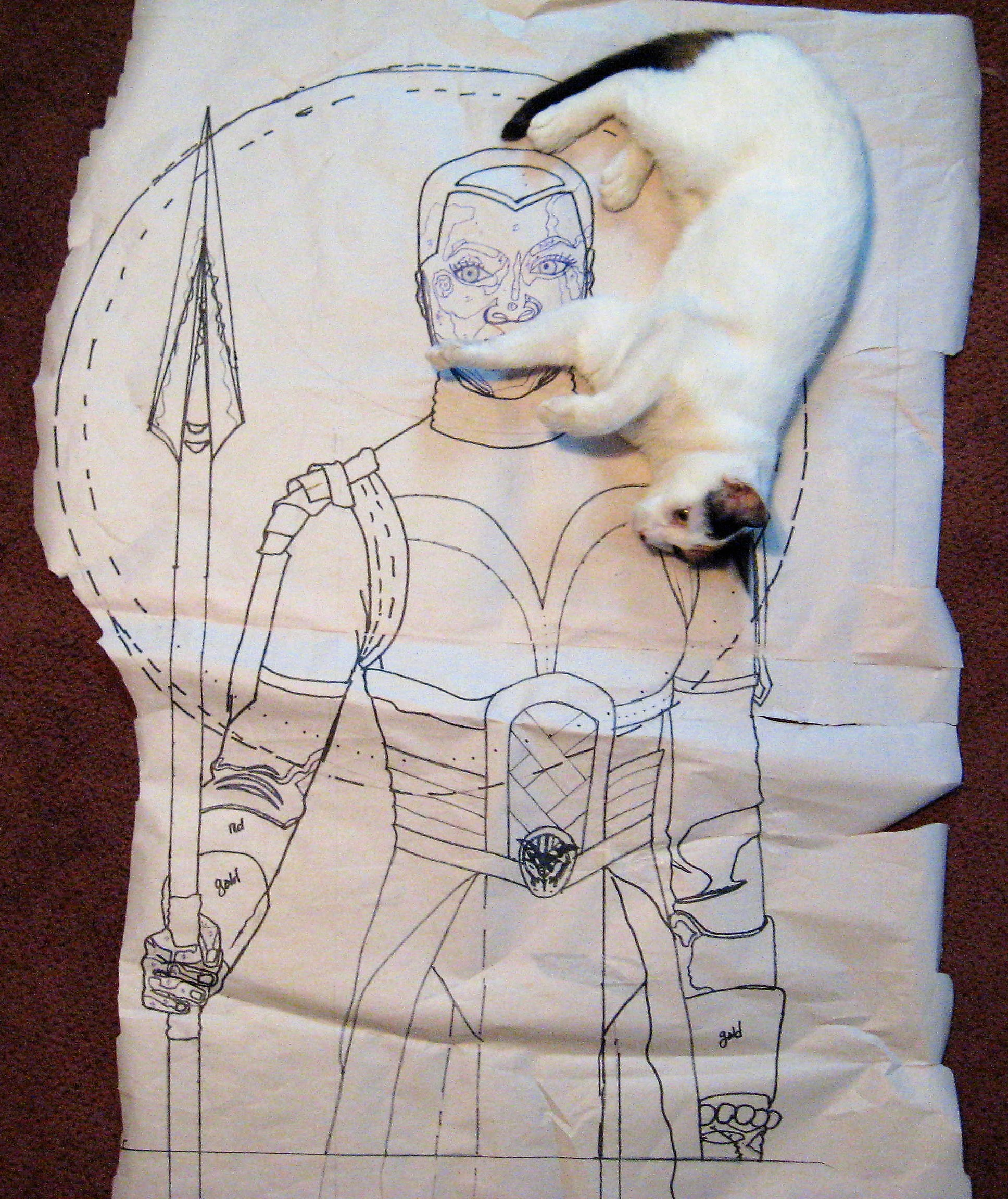 This is the drawing with a photo bomb from Callie! When I begin a quilt I have to choose what will be done in fused applique, thread painting, embellishments and fabric painting. While I was beginning this quilt the Upper Michigan weather has been full of snowstorms, icy drizzle and the return of the polar vortex. I had extra free time due to snow days at my salon job. Also the announcement of the Academy Award categories were happening as I was cutting out the applique pieces. I was very excited Black Panther had secured so many nominations. When the costumes from Black Panther were included in the Costume Design category I learned who the designer was-Ruth E. Carter. I have now began to follow all of her social media pages and realize she has been doing movie costume design for ever and I pray this talented woman wins in her category tonight at the Oscars!