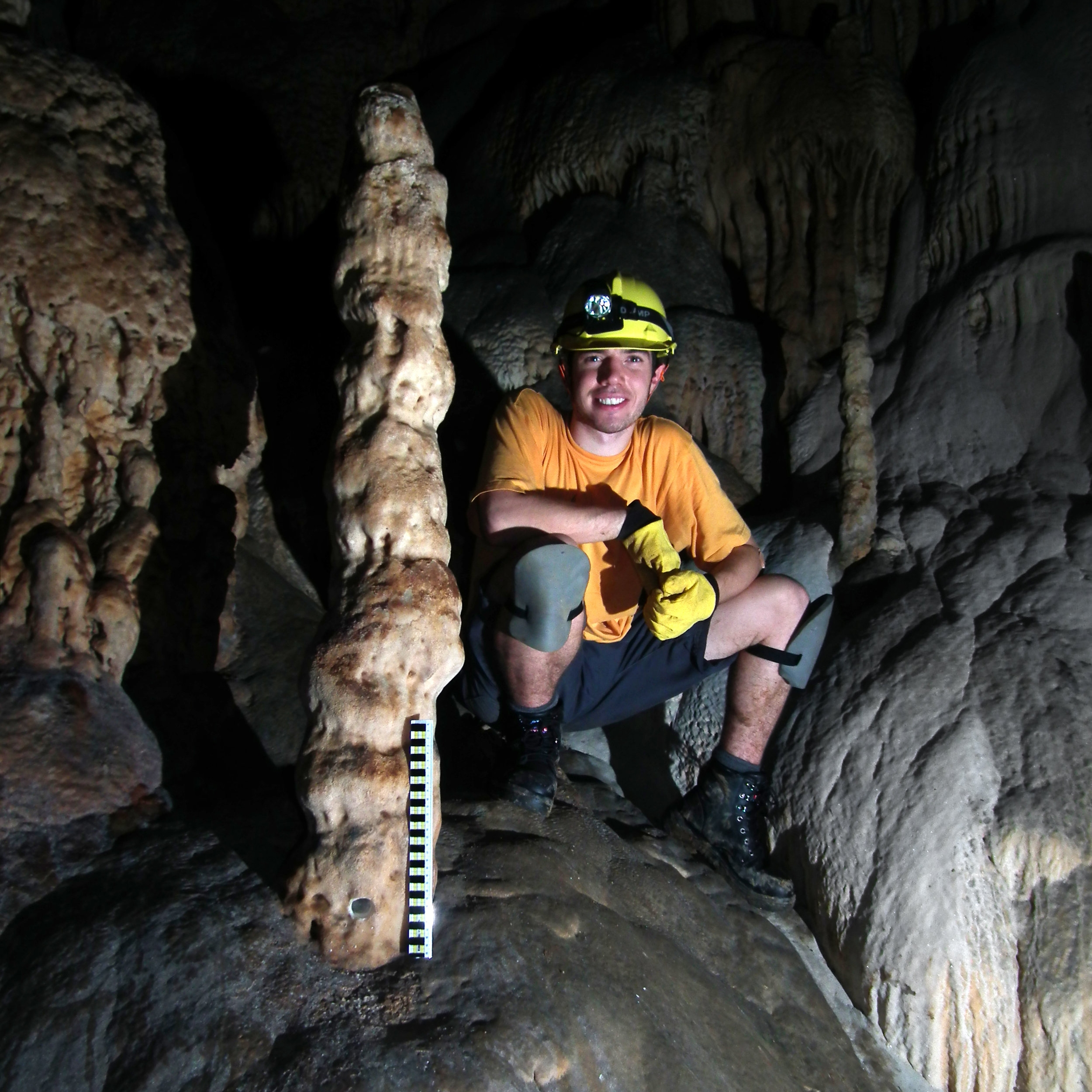 With stalagmite in Sulawesi