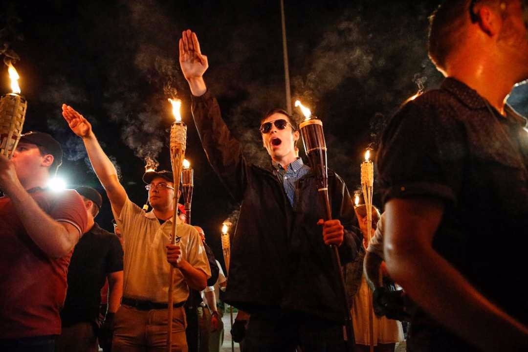 Image from Mykal McEldowney/IndyStar via USA TODAY Network  In Charlottesville, Virginia 11/8/17 a group of neo-Nazis and White supremacists walked through the University of Virginia following a months-long debate over a Statue of Confederate General Robert E. Lee. Many Confederate statues have come under debate over the last of years as the statues are remnants of racist ideals left by violent slave mongering colonizers that unfortunately still linger, persist, and are re-ignited far too often and far too easily.