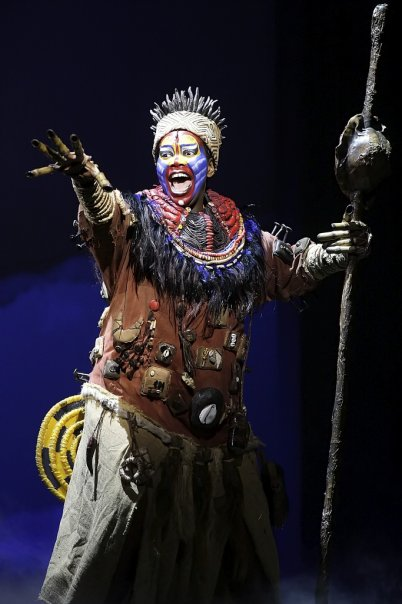"""Actress Buyi Zama as Rafiki in Taiwan""  by The Lion King's Taiwan staff is licensed under  CC BY-SA 3.0"