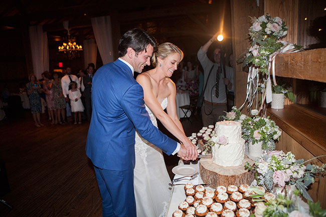 lane_Dittoe_carmel_wedding_reception_cake_cutting_23.jpg