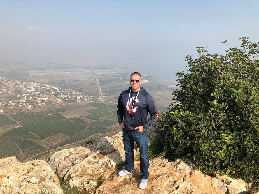 Rev. Dan with the Sea of Galilee to the right.