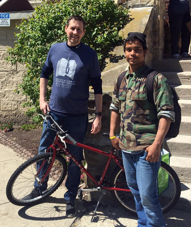 Brian Hintz donating first bike from Link-Up ministry at Twice Blessed Free Store.