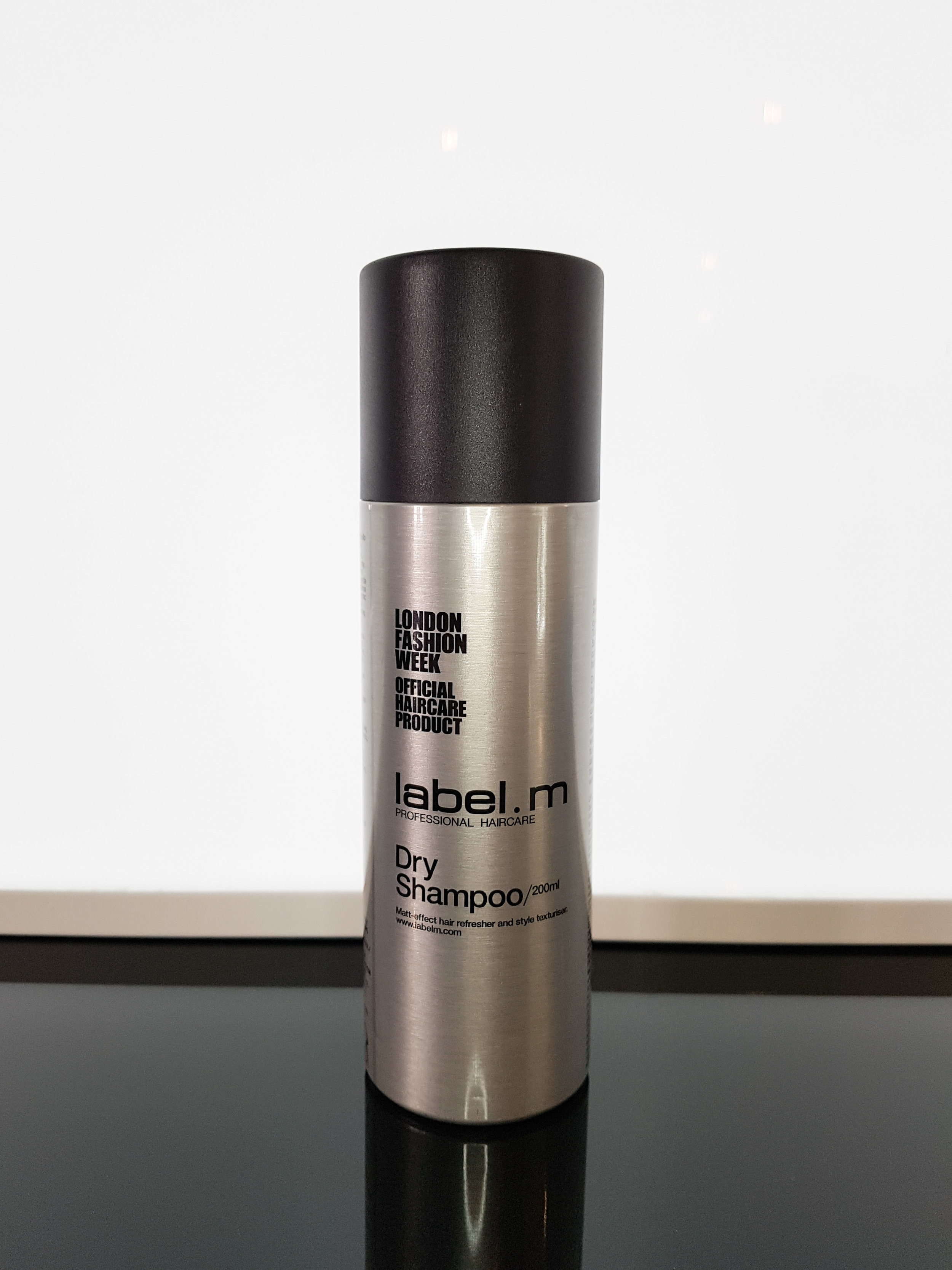 STEP 1 - Seperate the hair and spray in dry shampoo at the roots. Tip: to avoid getting that chalky affect, spray at a distance of around 30cm.