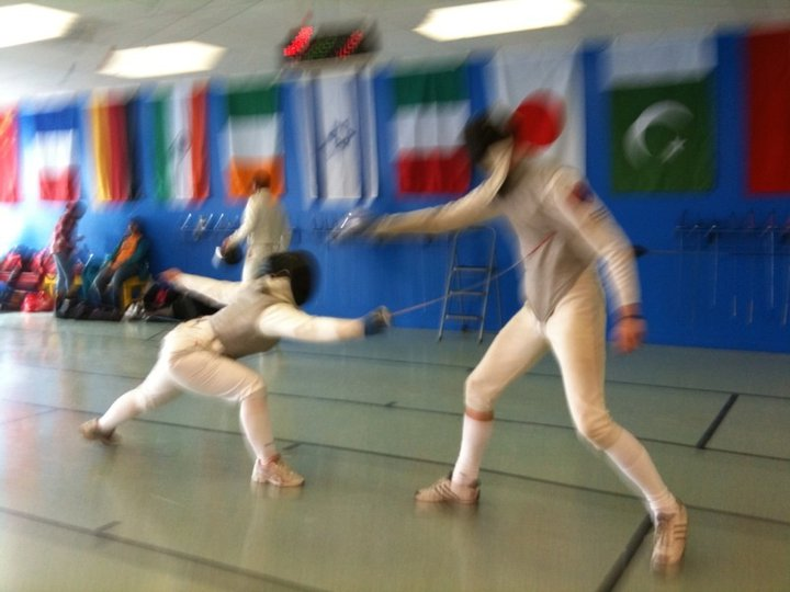 Stephanie Cole Adams fencing (left).