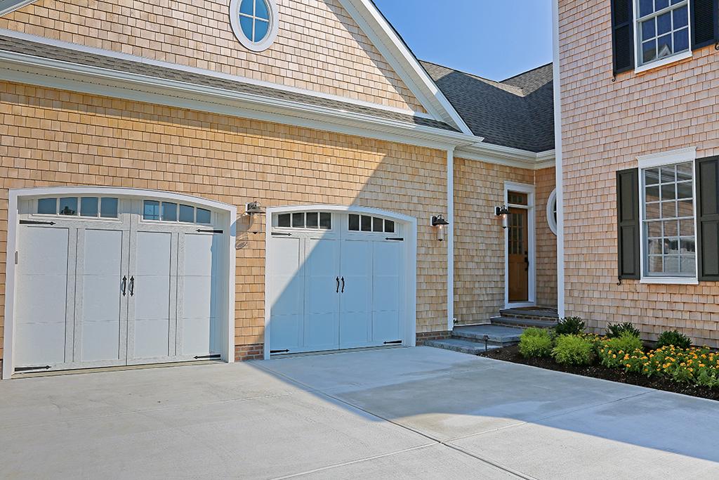 Cedar Siding Arched Garage Doors