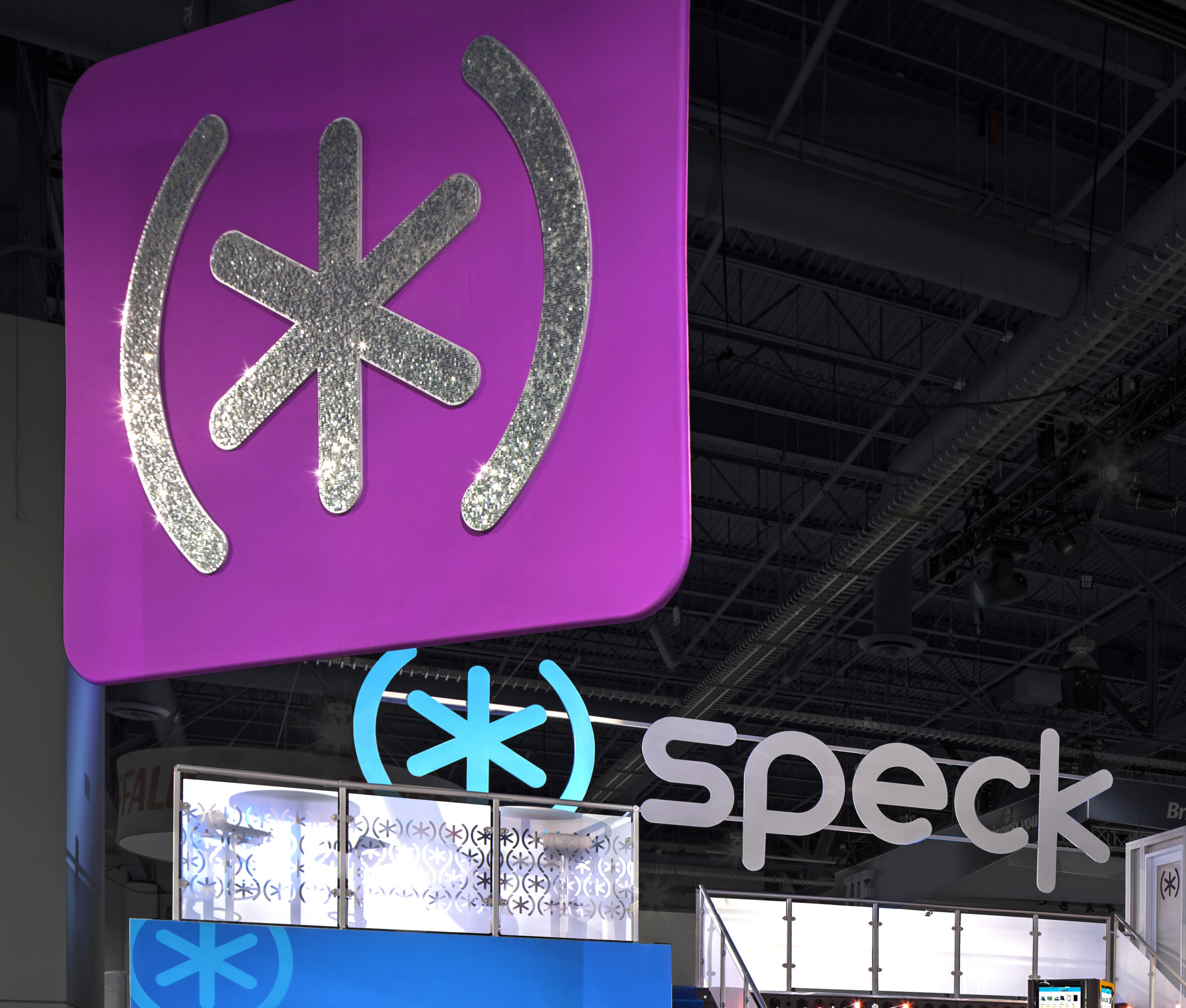 SPECK  Custom-cut hanging logo at CES