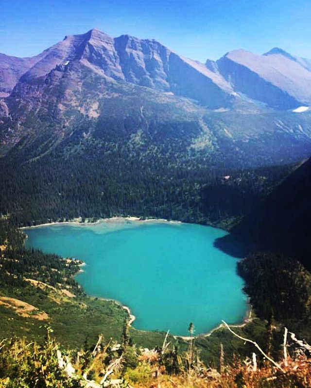 The photo is a tad smoky from the forest fires but the color of Grinnell Lake is mesmerizing. It's even more vibrant in person. The photo doesn't do it justice. Stay tuned for a full write up of our trip. #glaciernationalpark #grinnellglacierhike #getoutside #hiking #whyihike #montana