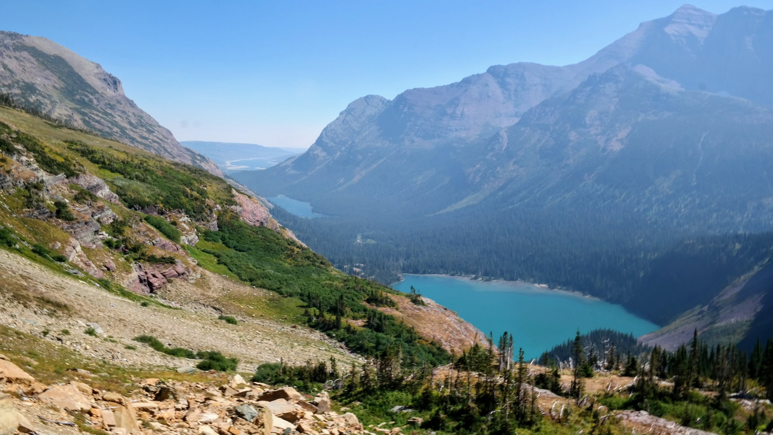 A view of lower Grinnell Lake looking back down the trail. Lake Josephine in the background.