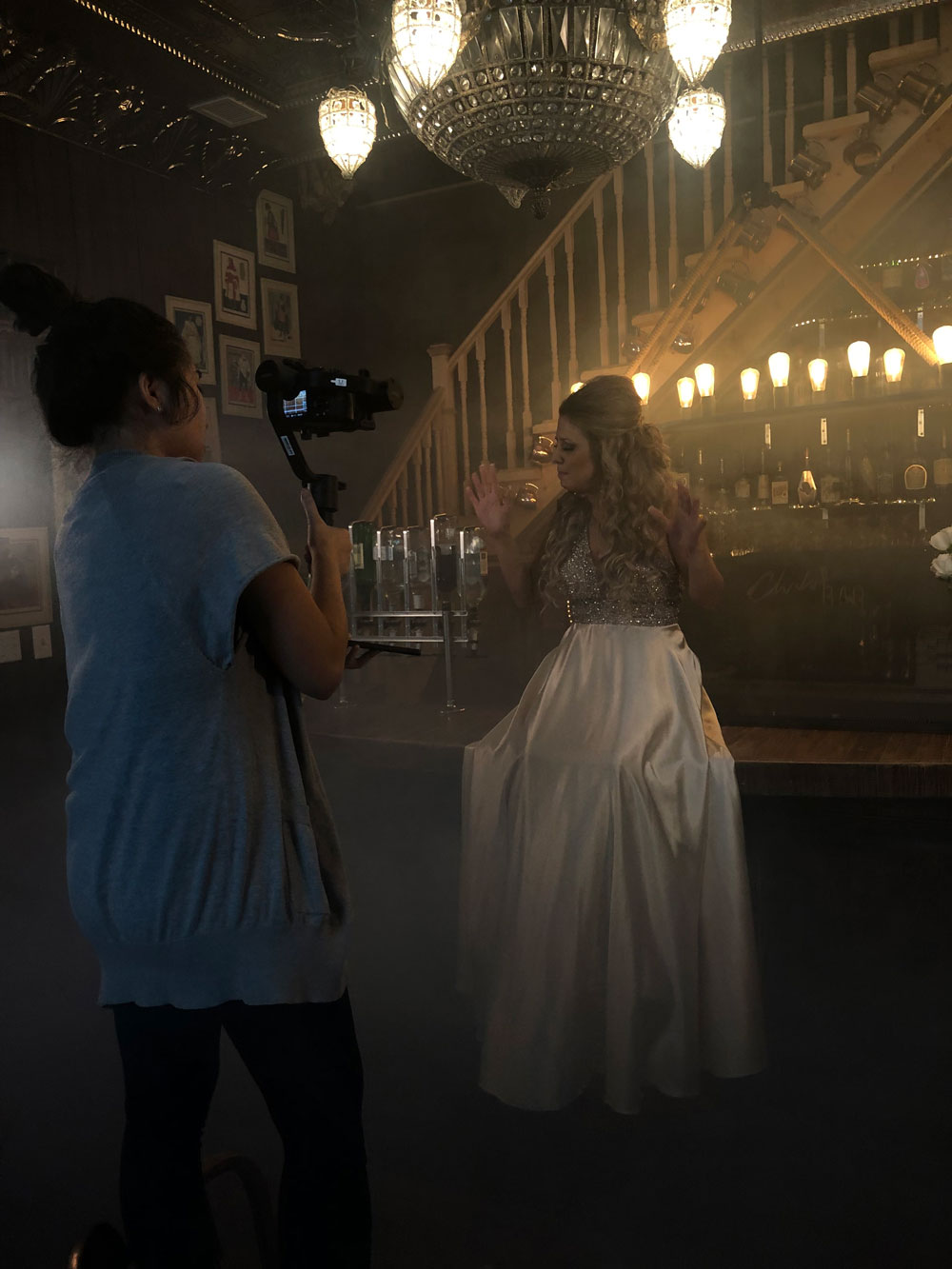 Behind the scenes photo of Andrea filming Lisa