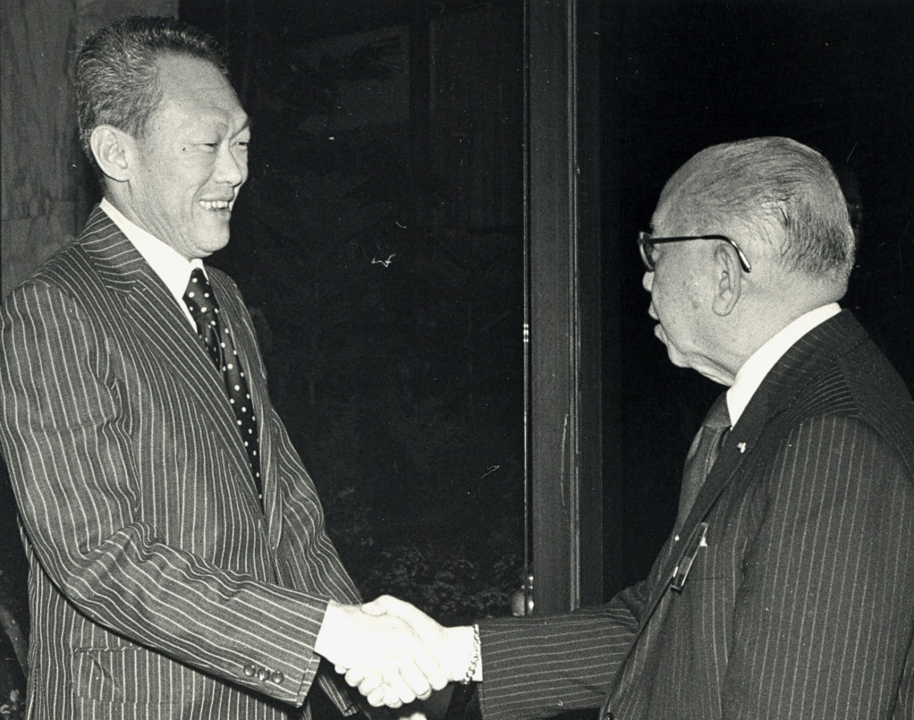 With Singapore's Prime Minister Lee Kuan Yew at the 10th ASEAN Ministerial Meeting, Singapore, July 1977.