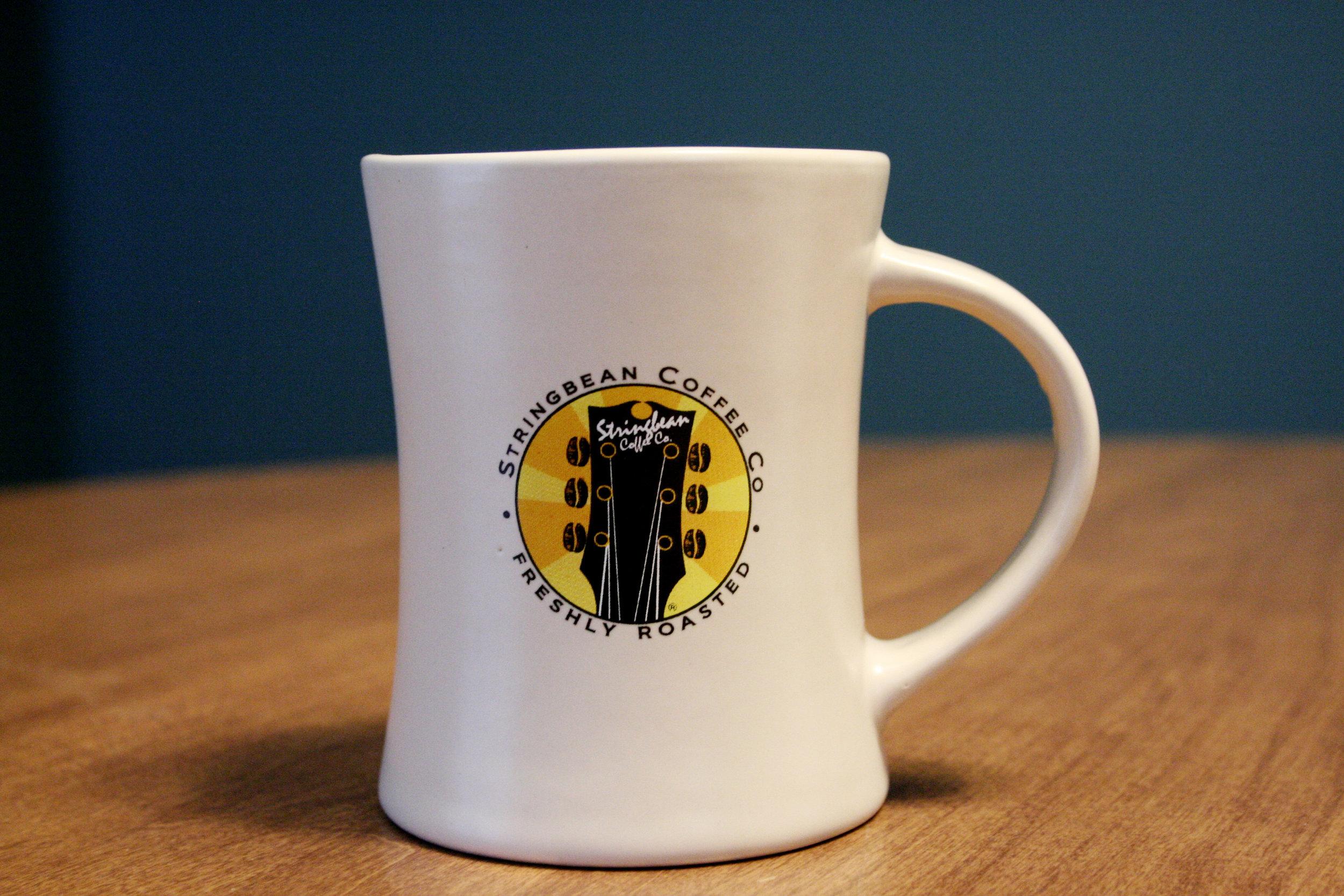 A coffee mug from Stringbean Coffee Company in St. Louis, Missouri.