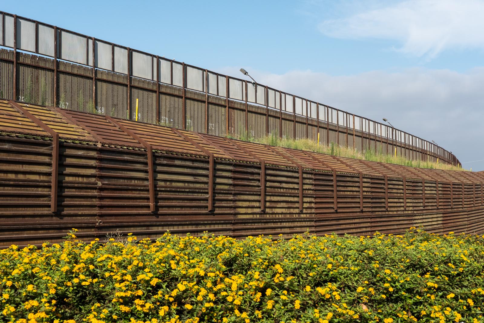 13. Hinterland - Border wall behind outlet stores, San Ysidro, CA.jpg