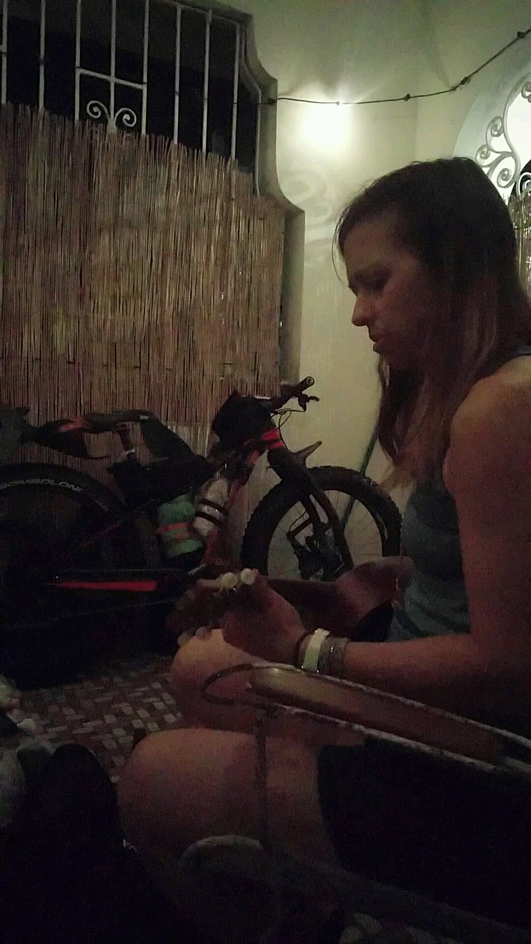 Playing ukulele on the patio as the rain pours down outside.
