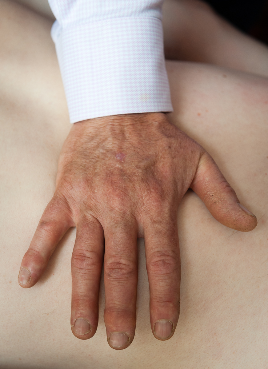 Using touch (palpation) to help identify health problems