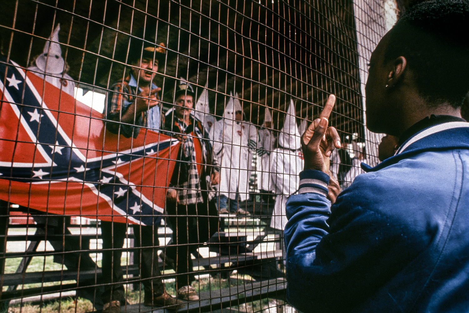 F*ck the KKK,  USA,  1990When the Ku Klux Klan , a white supremacist terrorist organization,  decided to march around a baseball field in a small town in southern New Jersey,  a crowd of protestors showed up to resist.  As the KKK donned their white robes and waved their confederate flags,  the protesting crowd, led by many black high school students,  pushed the Klan behind the ball field fence and into the wooden bleachers.  The Klan grew frightened and weak as the protesters outnumbered them.    Chanting with righteous anger and moral authority,  these teenagers drove the racist hate mongers  off the field and out of town. It was my privilege to witness this beautiful moment of resistance when young people stood up for their ancestors and their own dignity.