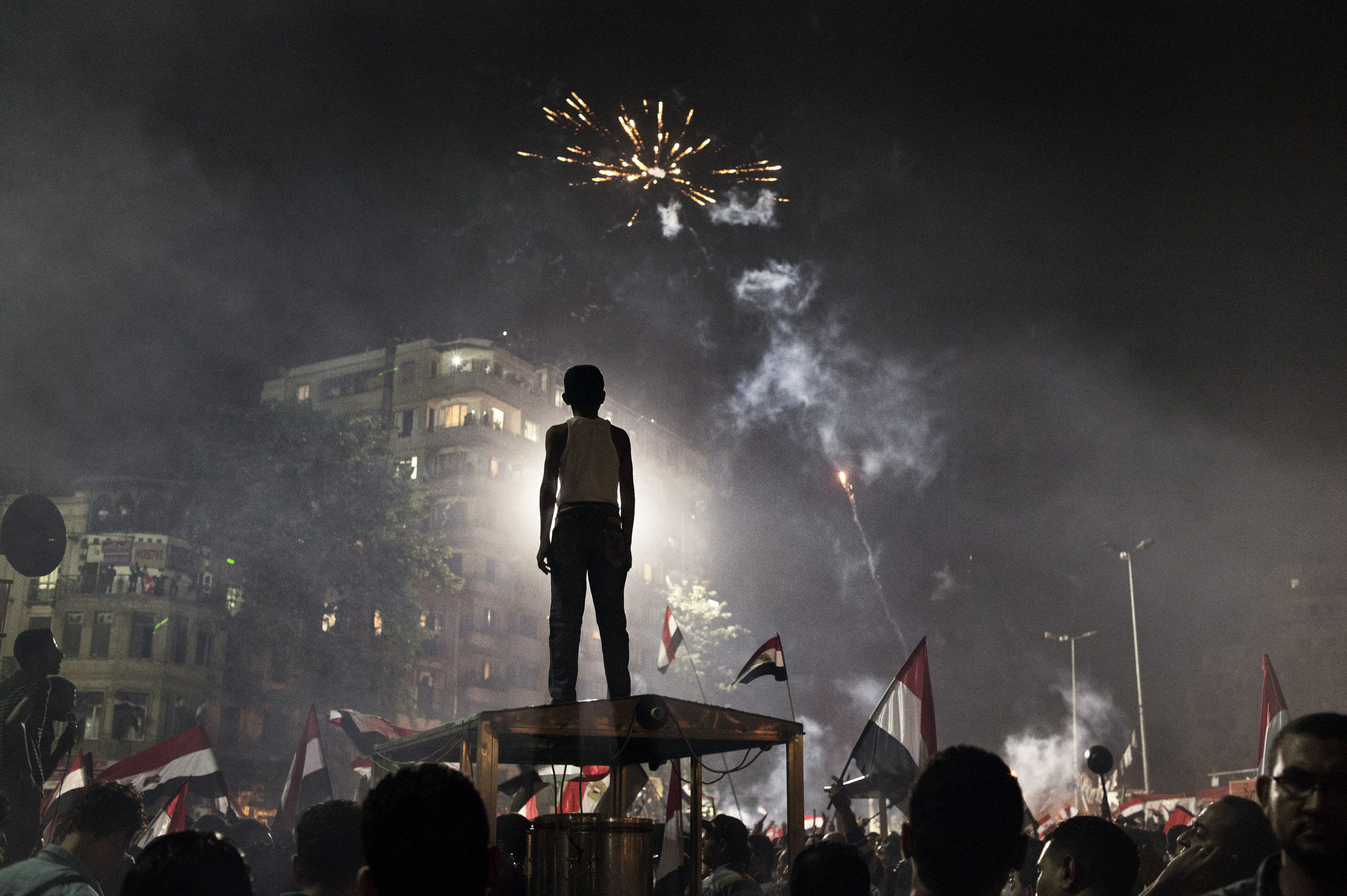 Cairo, Egypt. July 3, 2013. Fireworks light the sky after massive demonstrations turned to celebration in and around Tahrir Square, Cairo, as Egyptian President Mohamed Morsi was ousted by the military and taken into custody.