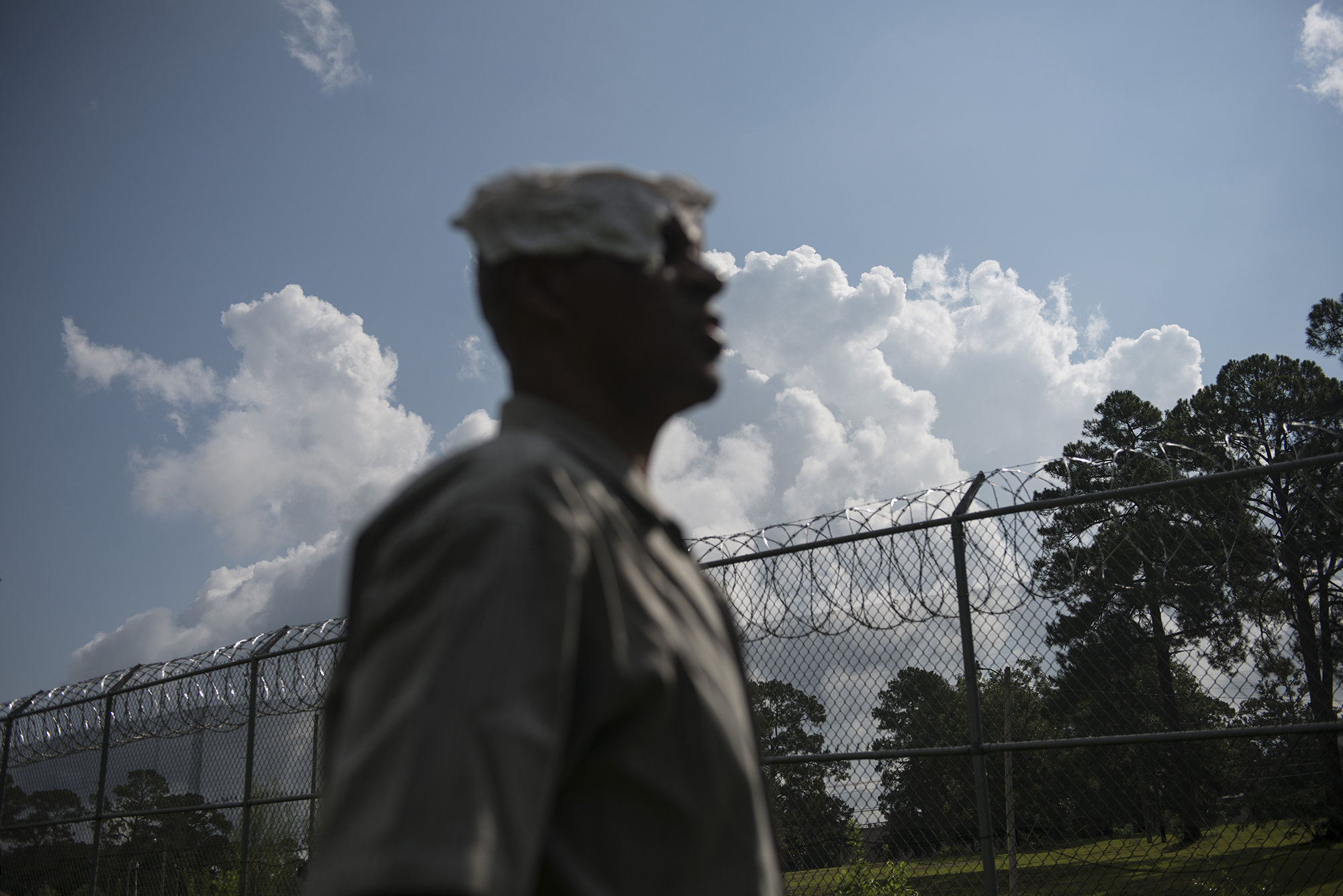 USA, Florida, Marianna, 03 August 2013, John Bonner looks out over barbed wire fencing at what was once the White House, where he was brutally beaten while sentenced at Dozier.