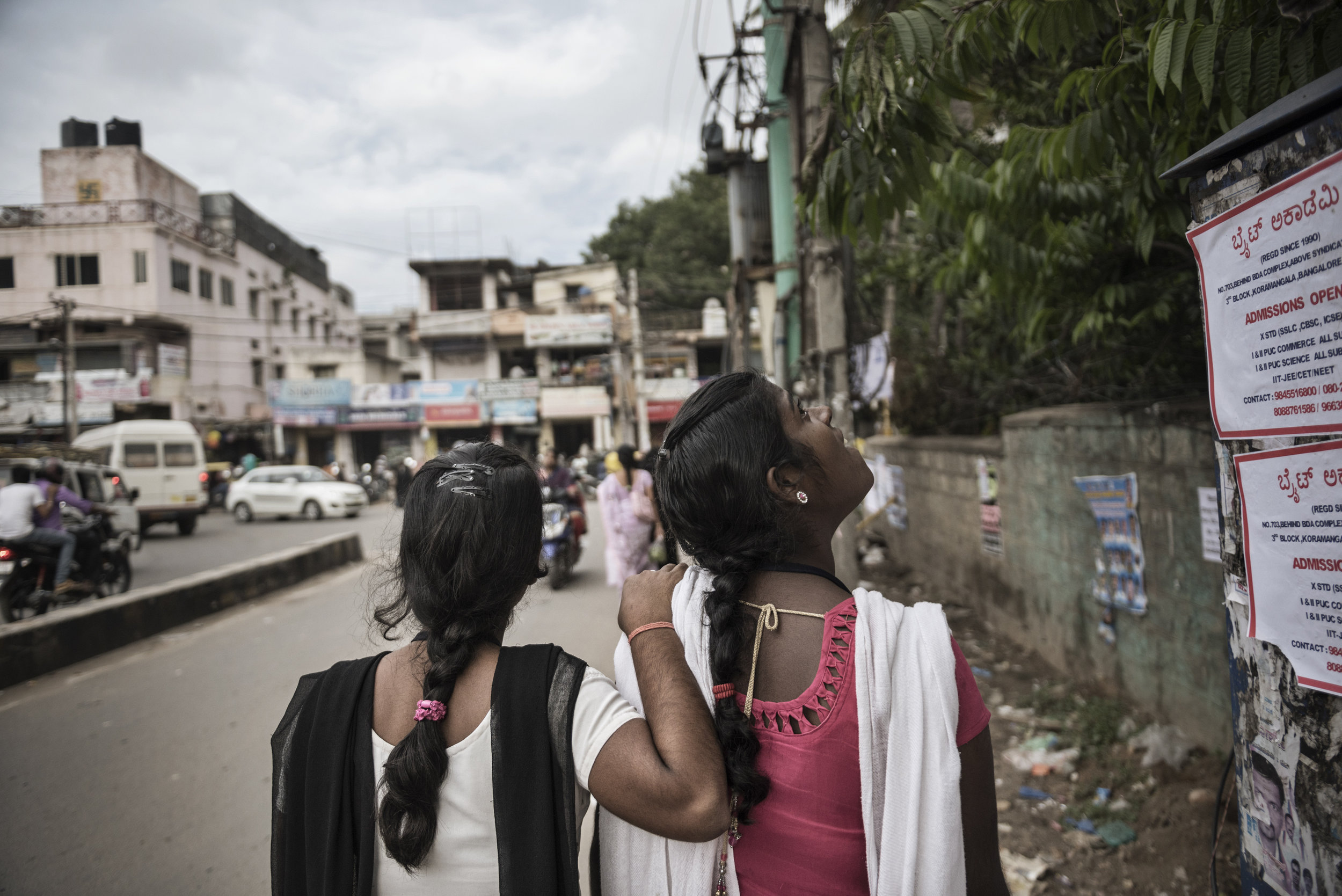 India, Bangalore, June 2016, Sisters Shashi and Prabhati, in awe of the city of Bangalore, walk from work at the factory to their dorm.