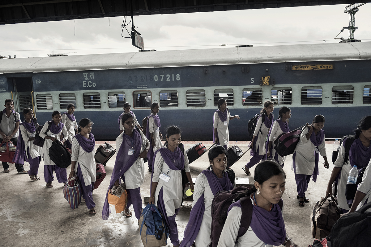 India, Bangalore, June 2016, Girls arriving in Bangalore in June from rural villages for their new factory jobs.