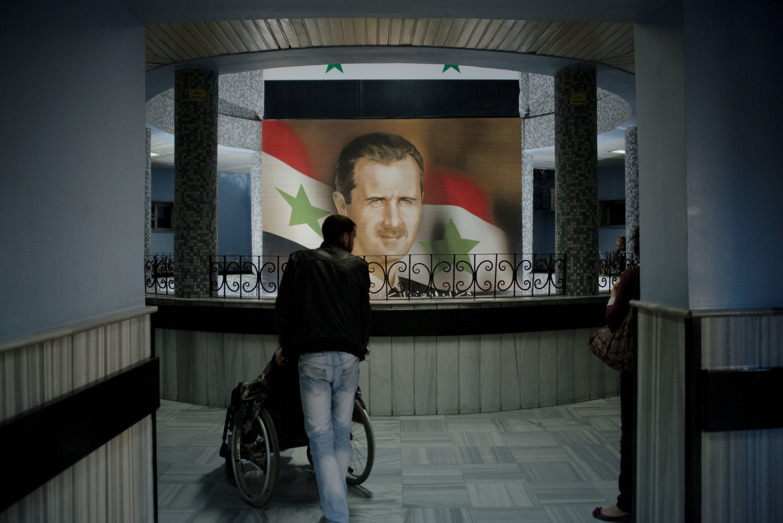 Syria, Damascus, March 2013, Portrait of Syrian President Bashar al-Assad hangs at the Mujtahid Hospital in Damascus where injured were taken after a mortar fell on the Damascus University Faculty of Engineering in Damascus Thursday. The Dean of the University said 12 students died in the explosion.